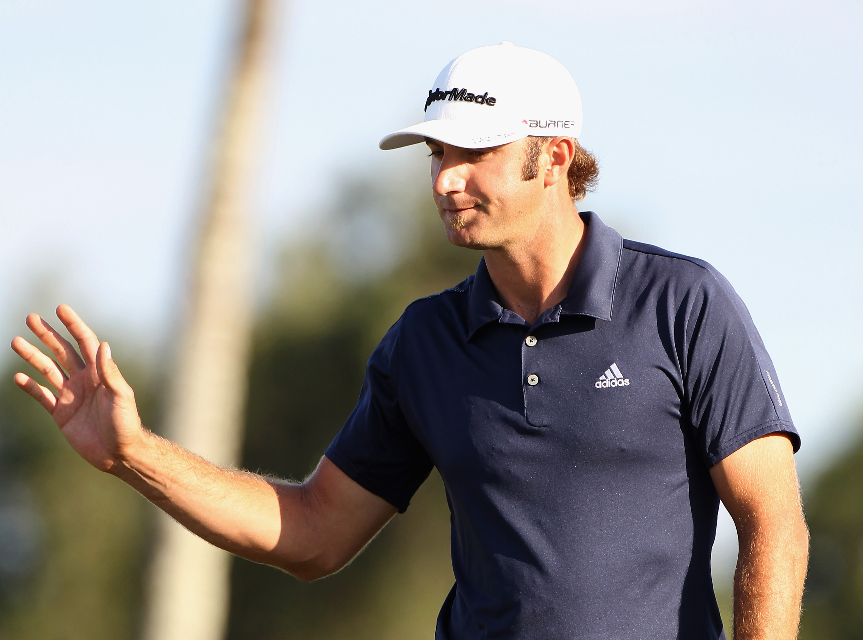 DORAL, FL - MARCH 12:  Dustin Johnson celebrates a birdie putt on the 17th hole during the third round of the 2011 WGC- Cadillac Championship at the TPC Blue Monster at the Doral Golf Resort and Spa on March 12, 2011 in Doral, Florida.  (Photo by Sam Gree