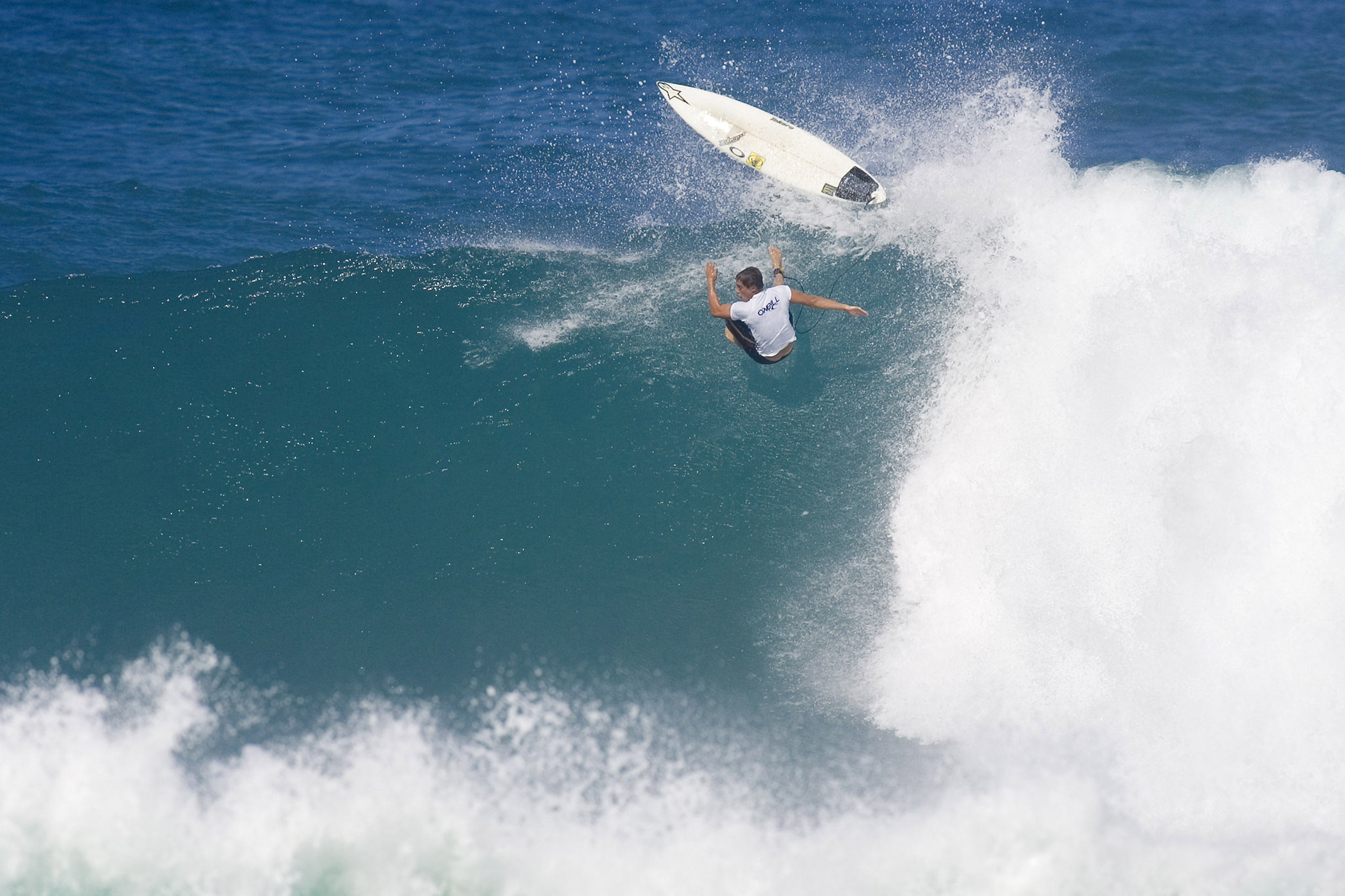 OAHU, HI - NOVEMBER 27:  (EDITORIAL USE ONLY) In this handout from Tostee.com, despite suffering a heavy wipeout, Makua Rothman (HI) wins his heat against Adrian Buchan of Australia, Bernardo Pigmeu of Brazil and Mike Todd of Australia in the round of 96