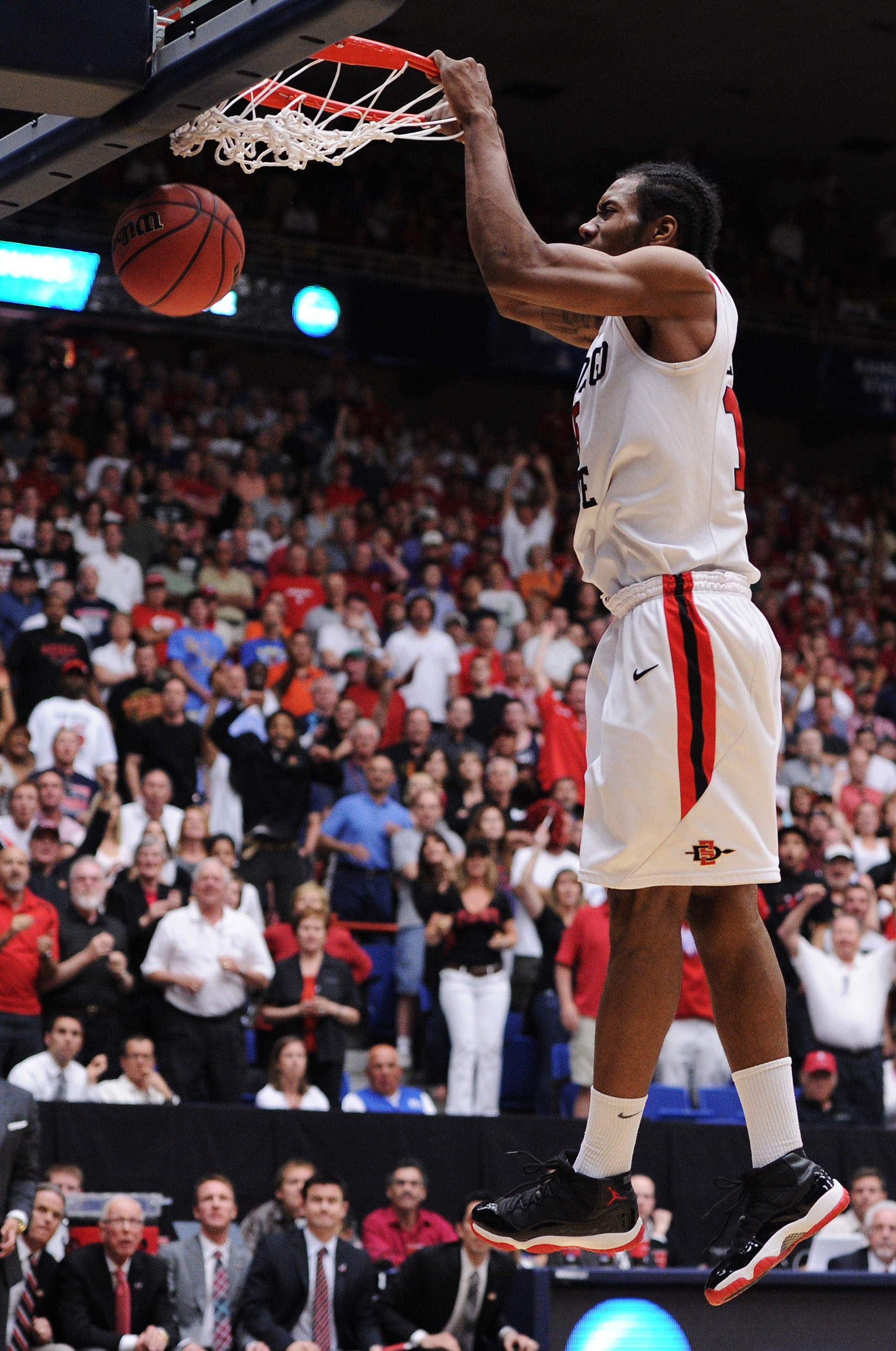 TUCSON, AZ - MARCH 19:  Kawhi Leonard #15 of the San Diego State Aztecs scores the final basket in double overtime against the Temple Owls in the third round of the 2011 NCAA men's basketball tournament at McKale Center on March 19, 2011 in Tucson, Arizon