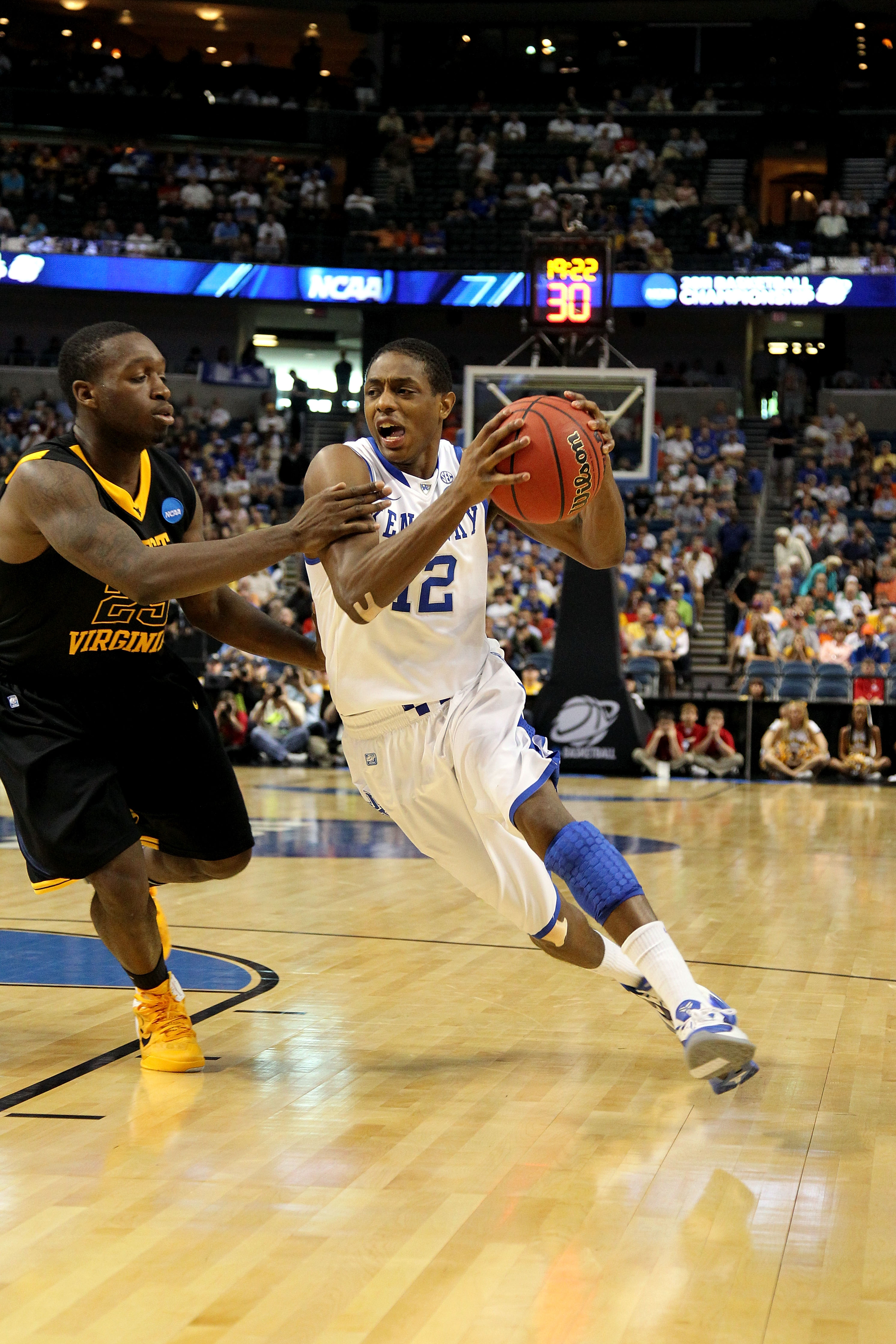TAMPA, FL - MARCH 19:  Brandon Knight #12 of the Kentucky Wildcats drives against Darryl Bryant #25 of the West Virginia Mountaineers during the third round of the 2011 NCAA men's basketball tournament at St. Pete Times Forum on March 19, 2011 in Tampa, F