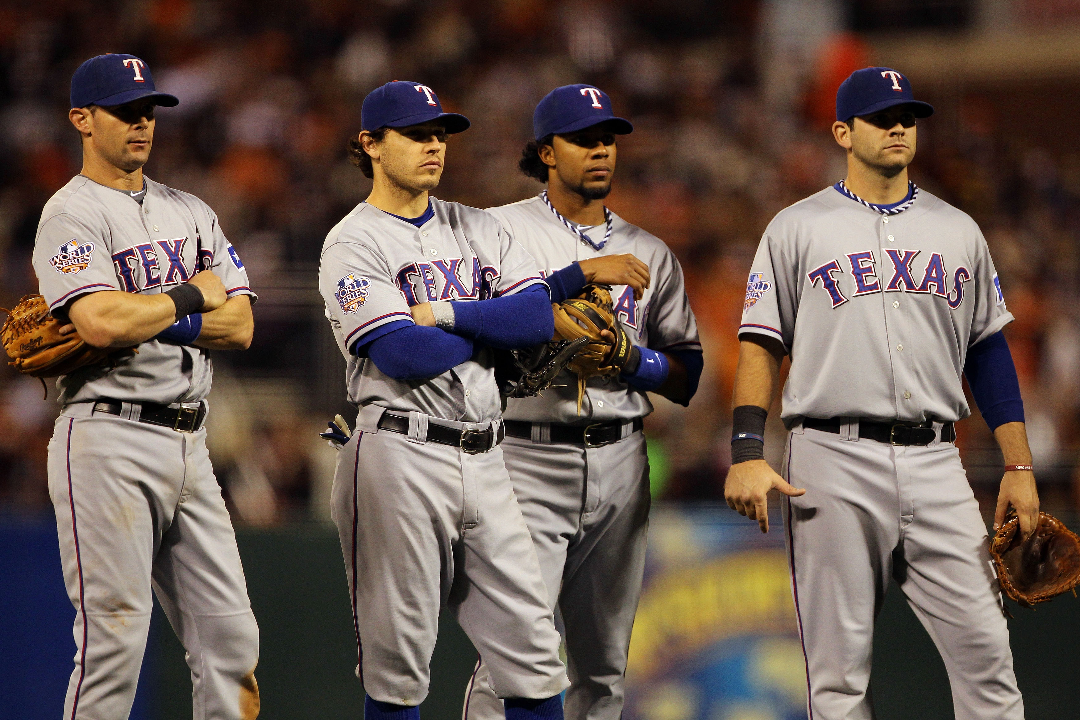 SAN FRANCISCO - OCTOBER 28:  (L-R) Michael Young #10, Ian Kinsler #5, Elvis Andrus #1 and Mitch Moreland #18 of the Texas Rangers stand together during a pitching change in the seventh inning while taking on the San Francisco Giants in Game Two of the 201