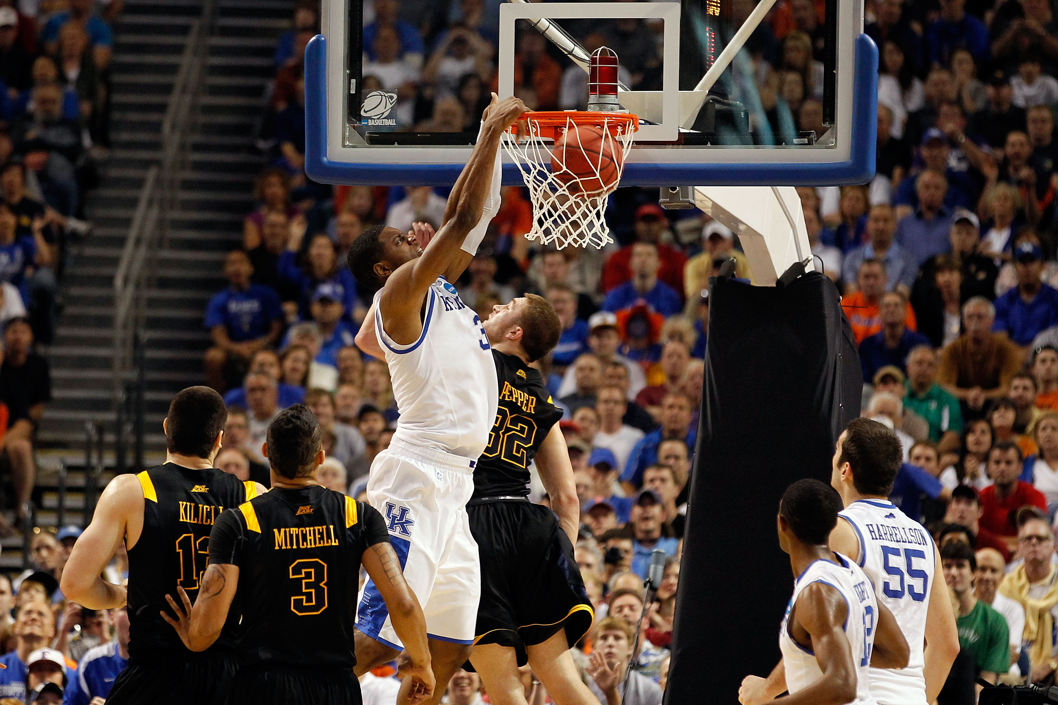 TAMPA, FL - MARCH 19:  Terrence Jones #3 of the Kentucky Wildcats dunks against Dalton Pepper #32 of the West Virginia Mountaineers during the third round of the 2011 NCAA men's basketball tournament at St. Pete Times Forum on March 19, 2011 in Tampa, Flo