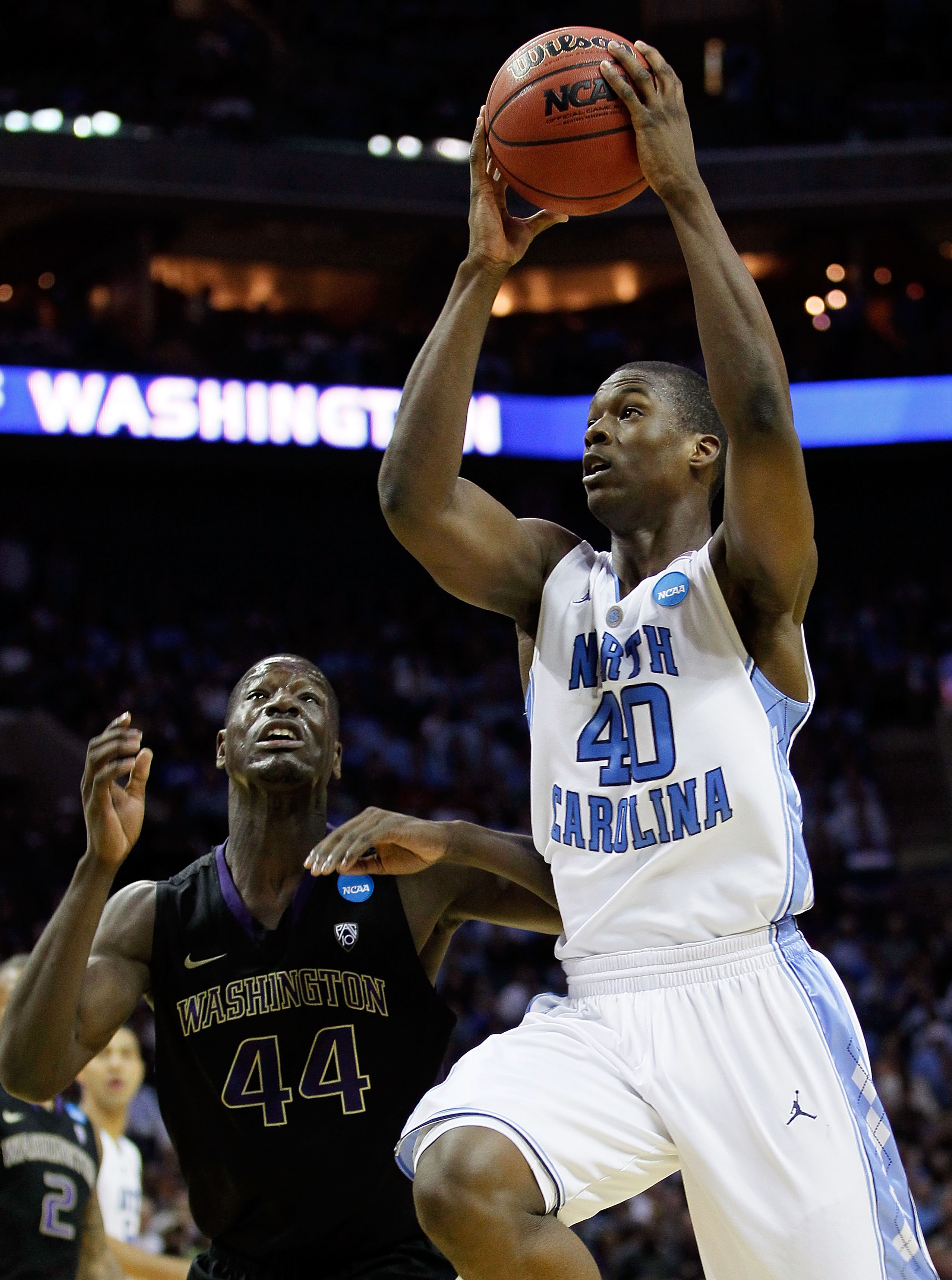 CHARLOTTE, NC - MARCH 20:  Harrison Barnes #40 of the North Carolina Tar Heels goes up for a shot against Darnell Gant #44 of the Washington Huskies in the second half during the third round of the 2011 NCAA men's basketball tournament at Time Warner Cabl