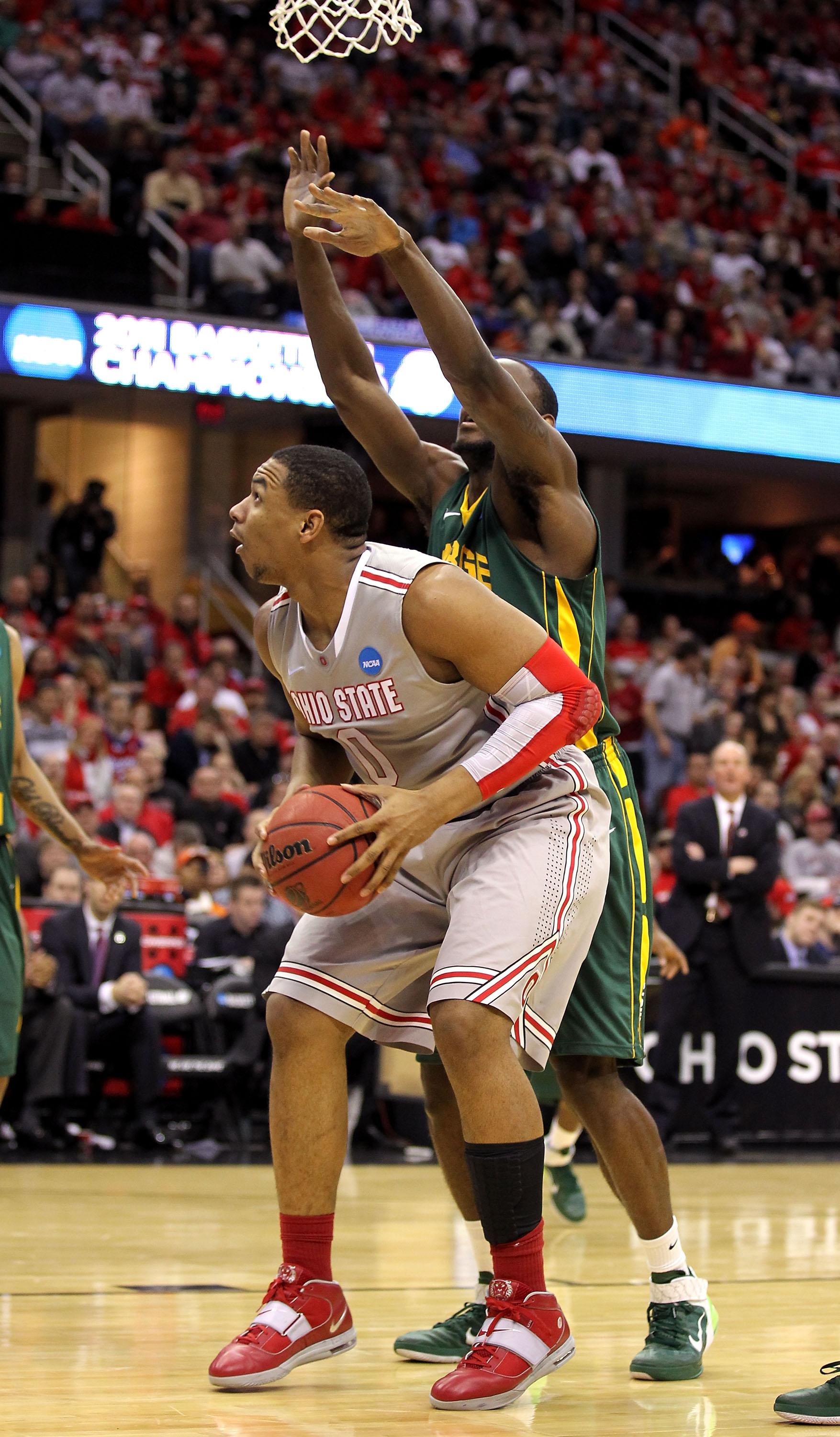 CLEVELAND, OH - MARCH 20: Jared Sullinger #0 of the Ohio State Buckeyes handles the ball against Mike Morrison #22 of the George Mason Patriots during the third of the 2011 NCAA men's basketball tournament at Quicken Loans Arena on March 20, 2011 in Cleve