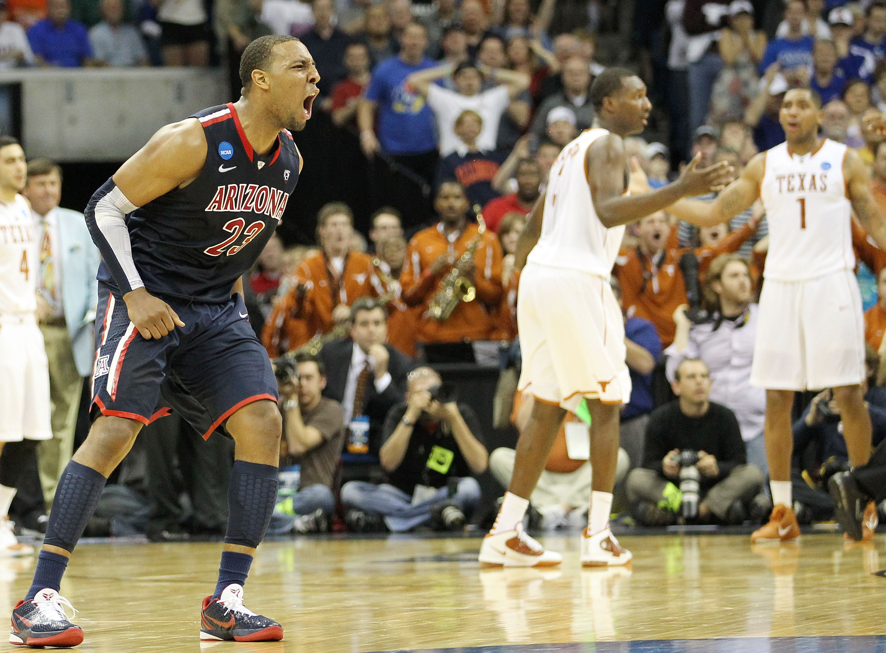 TULSA, OK - MARCH 20:  Derrick Williams #23 of the Arizona Wildcats celebrates after defeating the Texas Longhorns 70-69 in the third round of the 2011 NCAA men's basketball tournament at BOK Center on March 20, 2011 in Tulsa, Oklahoma.  (Photo by Ronald