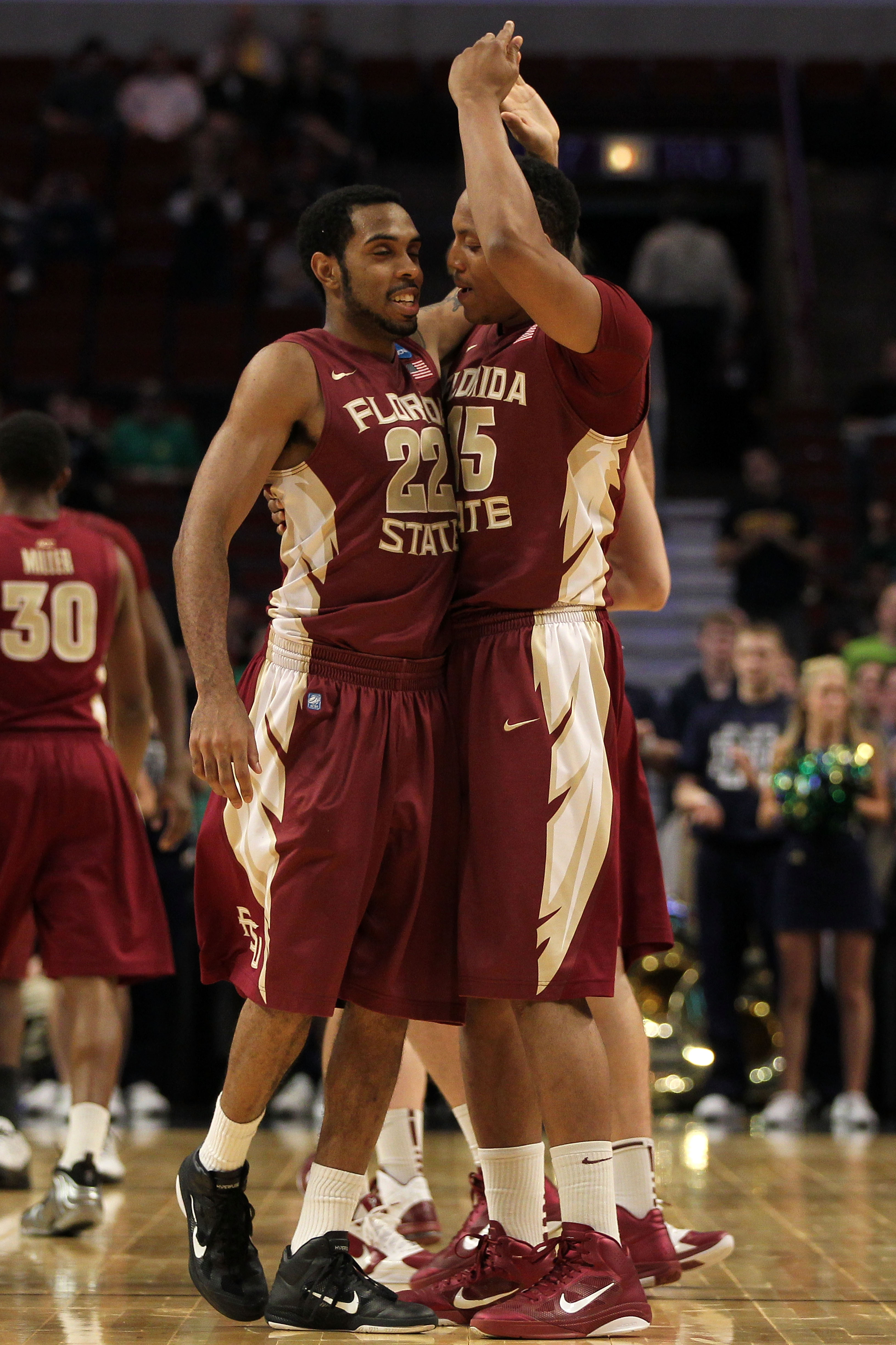 CHICAGO, IL - MARCH 20:  Derwin Kitchen #22 and Terrance Shannon #15 of the Florida State Seminoles celebrate in the second half of the game against the Notre Dame Fighting Irish during the third round of the 2011 NCAA men's basketball tournament at the U