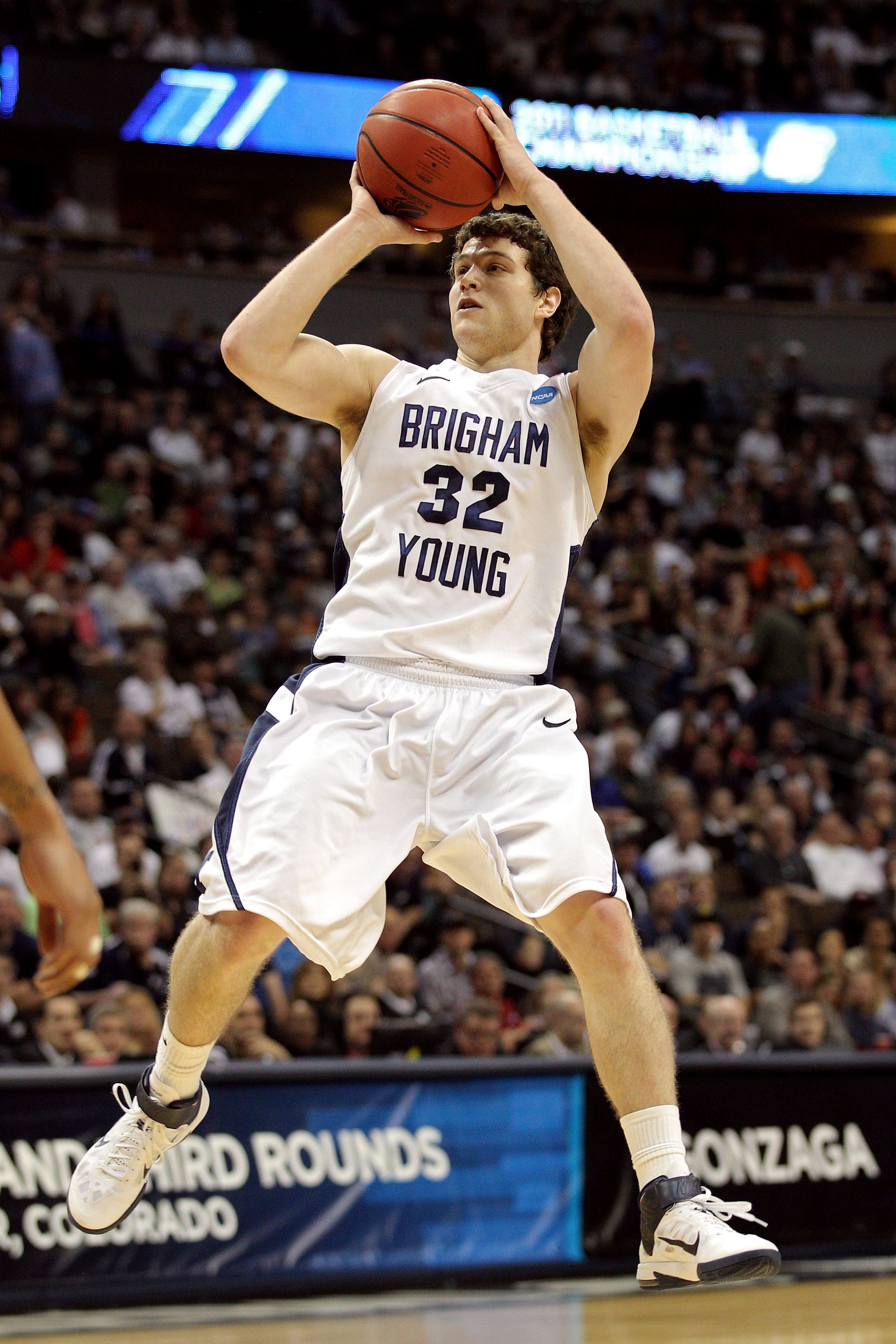 DENVER, CO - MARCH 19:  Jimmer Fredette #32 of the Brigham Young Cougars shoot against the Gonzaga Bulldogs during the third round of the 2011 NCAA men's basketball tournament at Pepsi Center on March 19, 2011 in Denver, Colorado.  (Photo by Justin Edmond