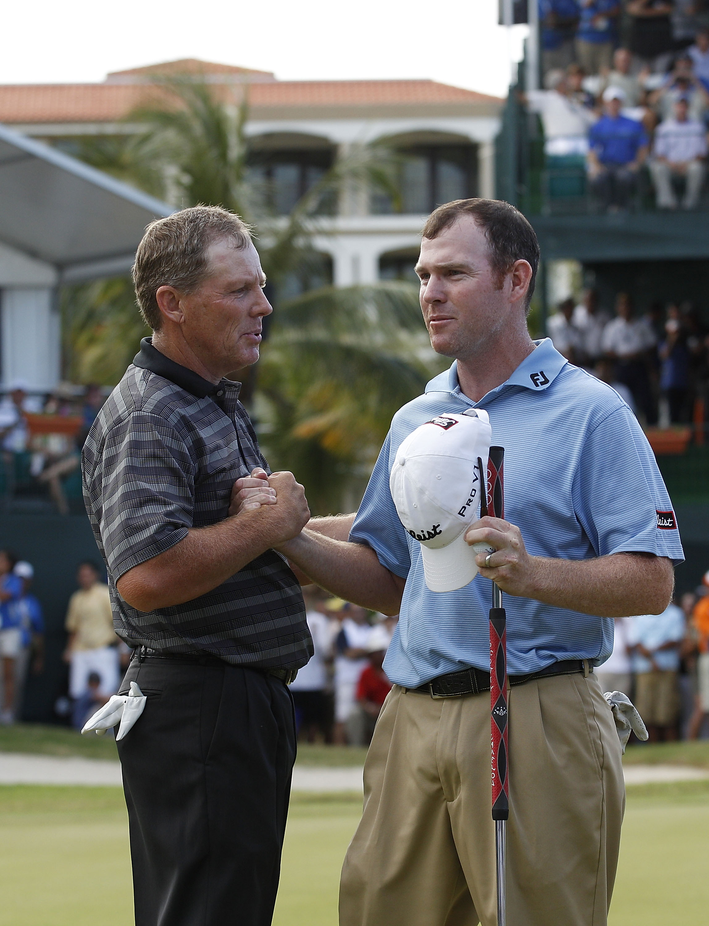 RIO GRANDE, PR - MARCH 13:  Michael Bradley (L) shakes hands with Troy Matteson whom he beat in a one hole playoff to win the Puerto Rico Open presented by seepuertorico.com at Trump International Golf Club on March 13, 2011 in Rio Grande, Puerto Rico.  (