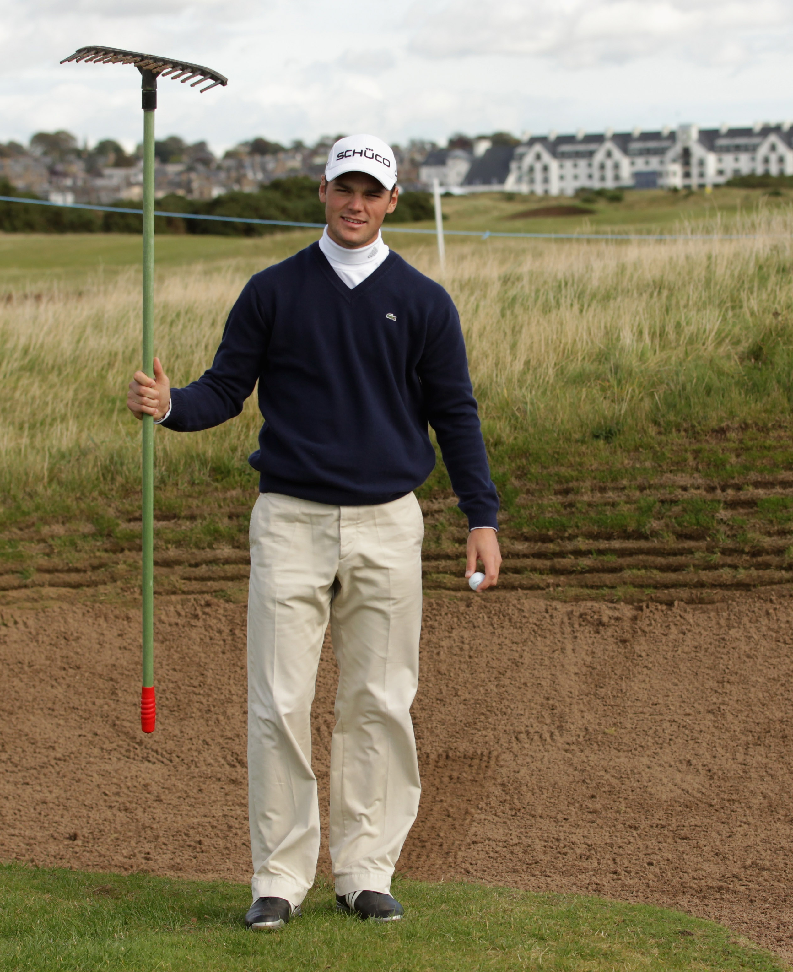 CARNOUSTIE, SCOTLAND - OCTOBER 06:  Martin Kaymer of Germany holds a bunker rake during a practice round for The Alfred Dunhill Links Championship at Carnoustie Golf Links on October 6, 2010 in Carnoustie, Scotland.  (Photo by Andrew Redington/Getty Image