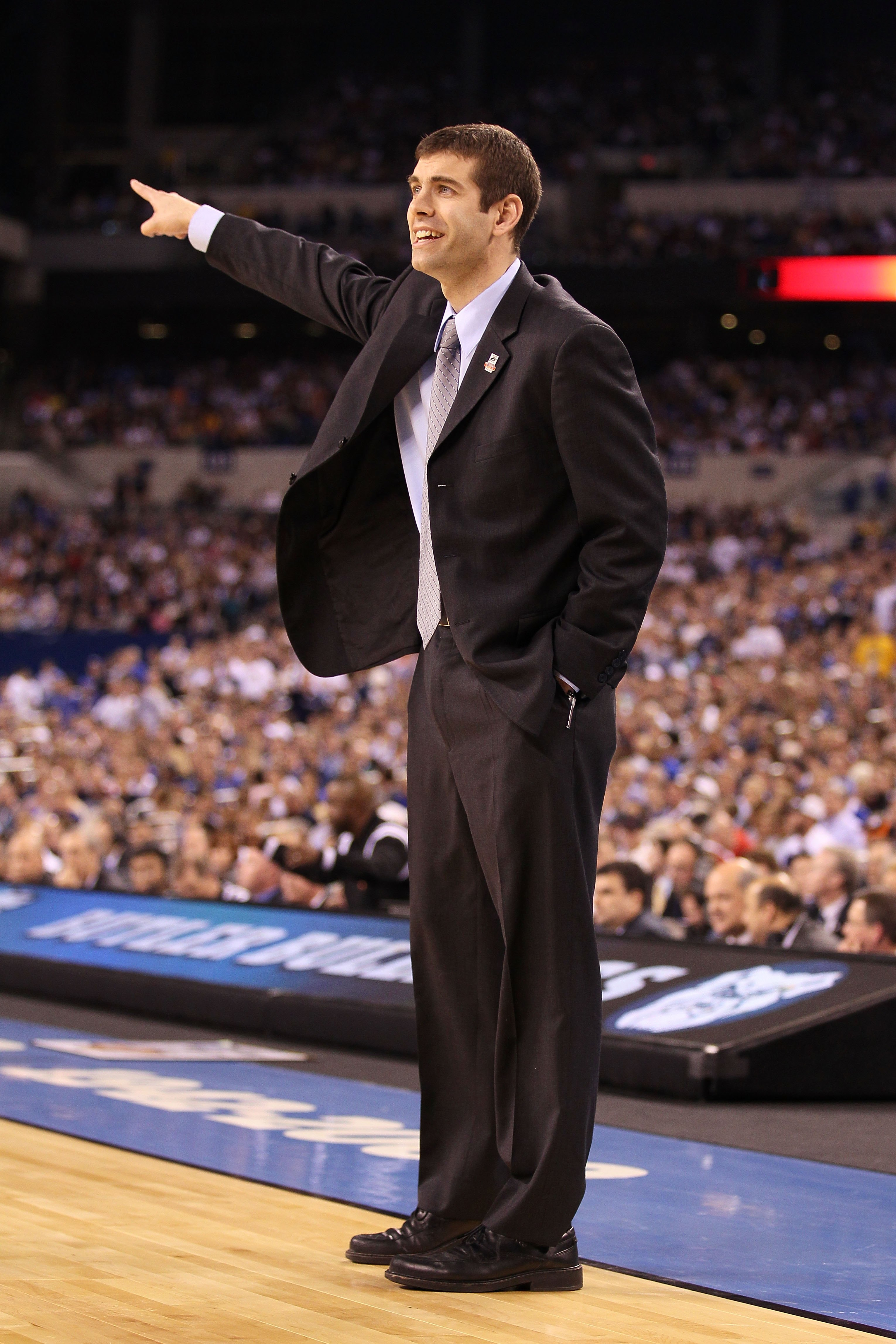 INDIANAPOLIS - APRIL 05:  Head coach Brad Stevens of the Butler Bulldogs smiles as he gestures against the Duke Blue Devils during the 2010 NCAA Division I Men's Basketball National Championship game at Lucas Oil Stadium on April 5, 2010 in Indianapolis,