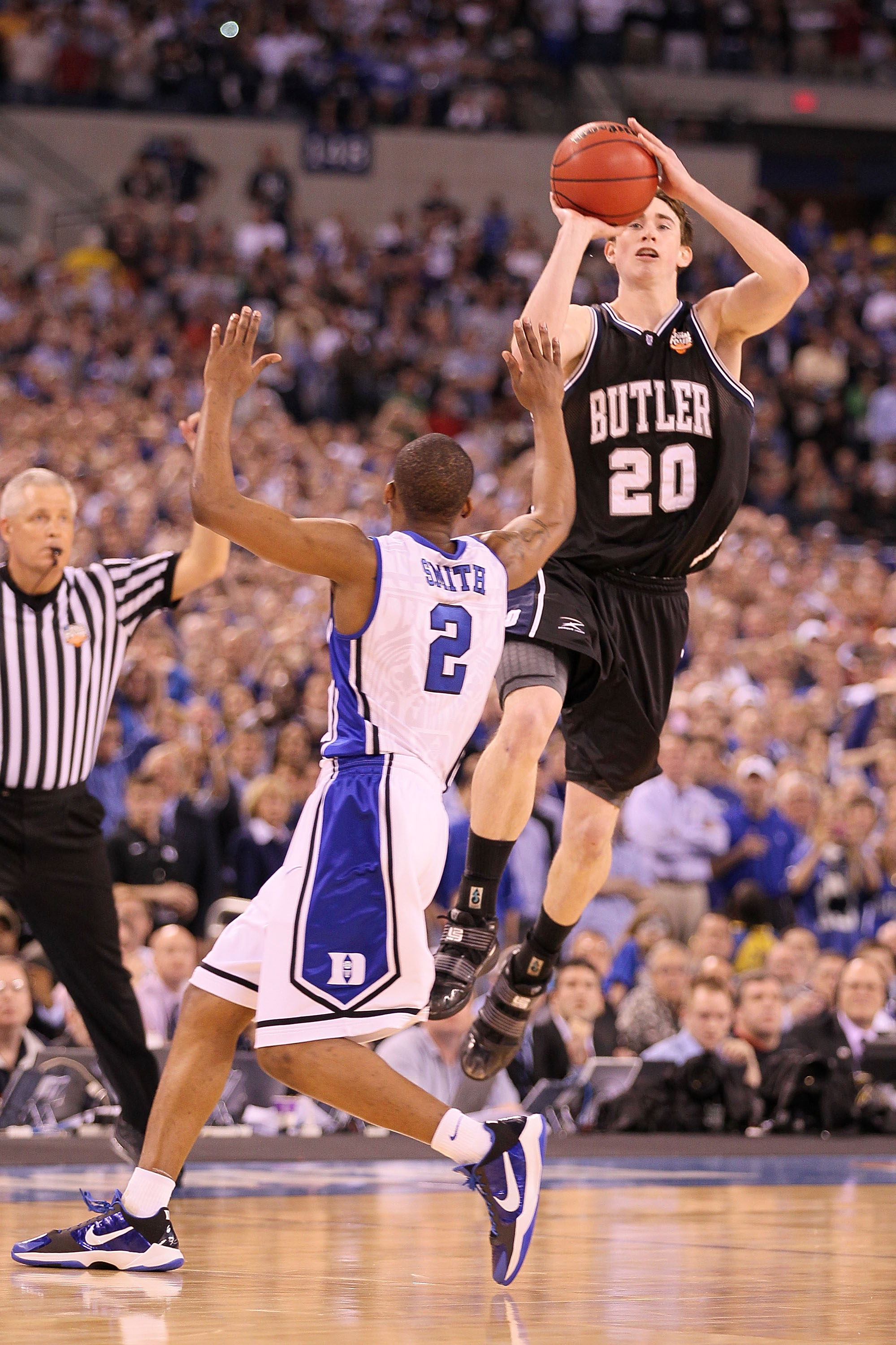 INDIANAPOLIS - APRIL 05:  Gordon Hayward #20 of the Butler Bulldogs shoots a last second shot from half court over Nolan Smith #2 of the Duke Blue Devils that missed during the 2010 NCAA Division I Men's Basketball National Championship game at Lucas Oil