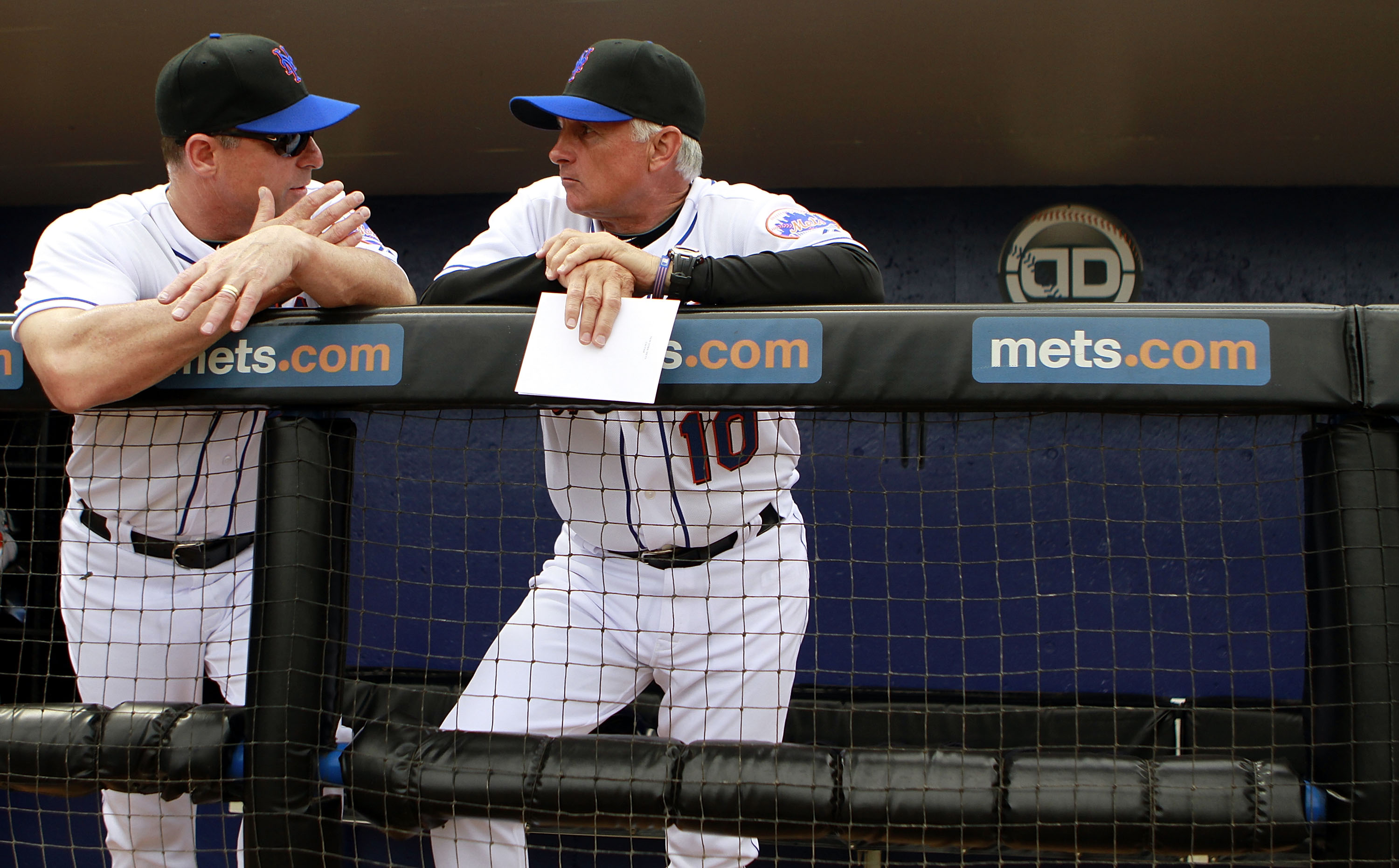 PORT ST. LUCIE, FL - FEBRUARY 26:  RY 26:  David Wright #5 and Manager Terry Collins (R) of the New York Mets chat prior to playing against the Atlanta Braves at Digital Domain Park on February 26, 2011 in Port St. Lucie, Florida.  (Photo by Marc Serota/G
