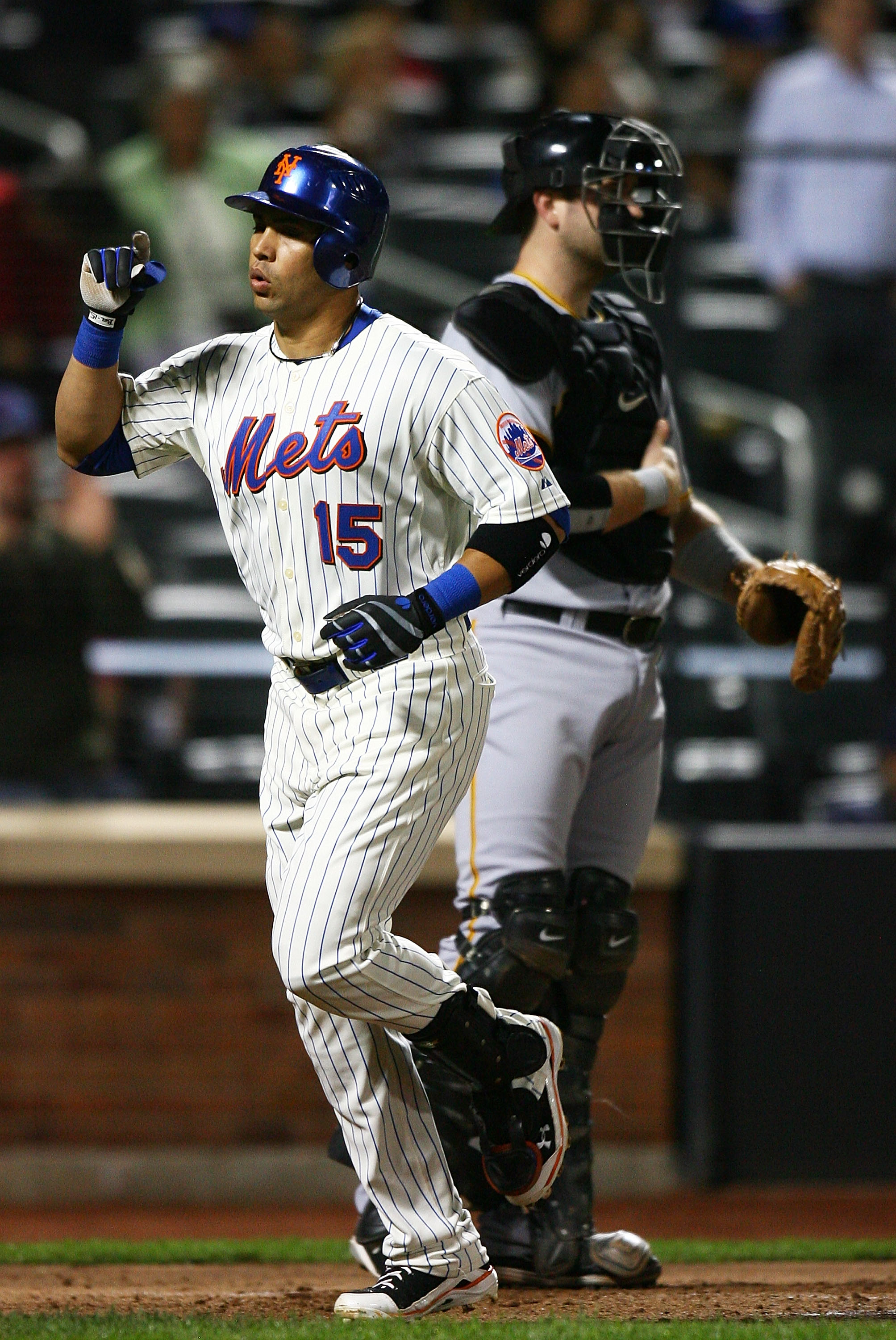 NEW YORK - SEPTEMBER 14:  Carlos Beltran #15 of the New York Mets celebrates after hitting a home run in the third inning against the Pittsburgh Pirates on September 14, 2010 at Citi Field in the Flushing neighborhood of the Queens borough of New York Cit