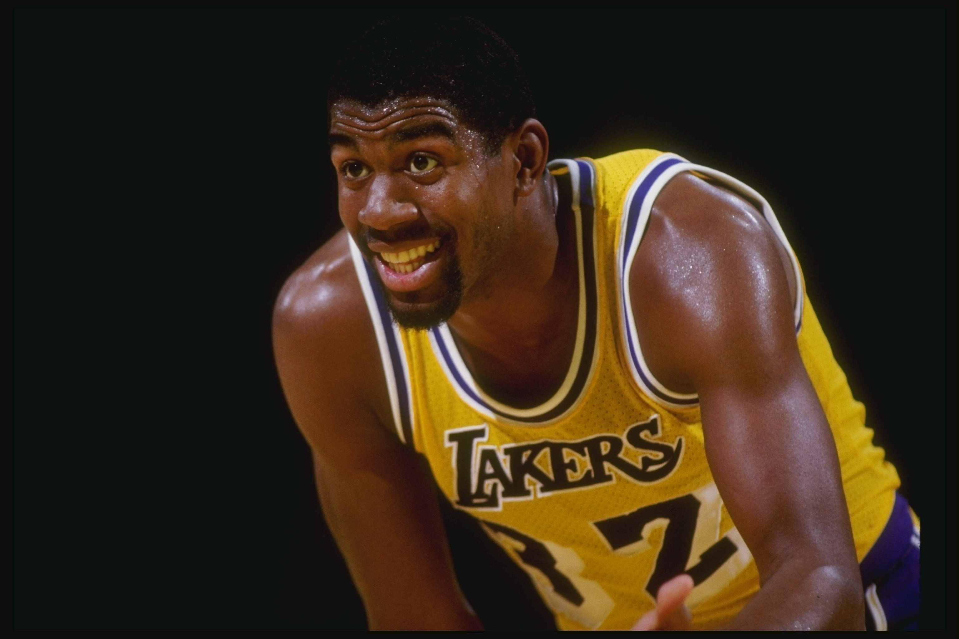 Guard Magic Johnson of the Los Angeles Lakers stands on the court during a game at the Great Western Forum in Inglewood, California.