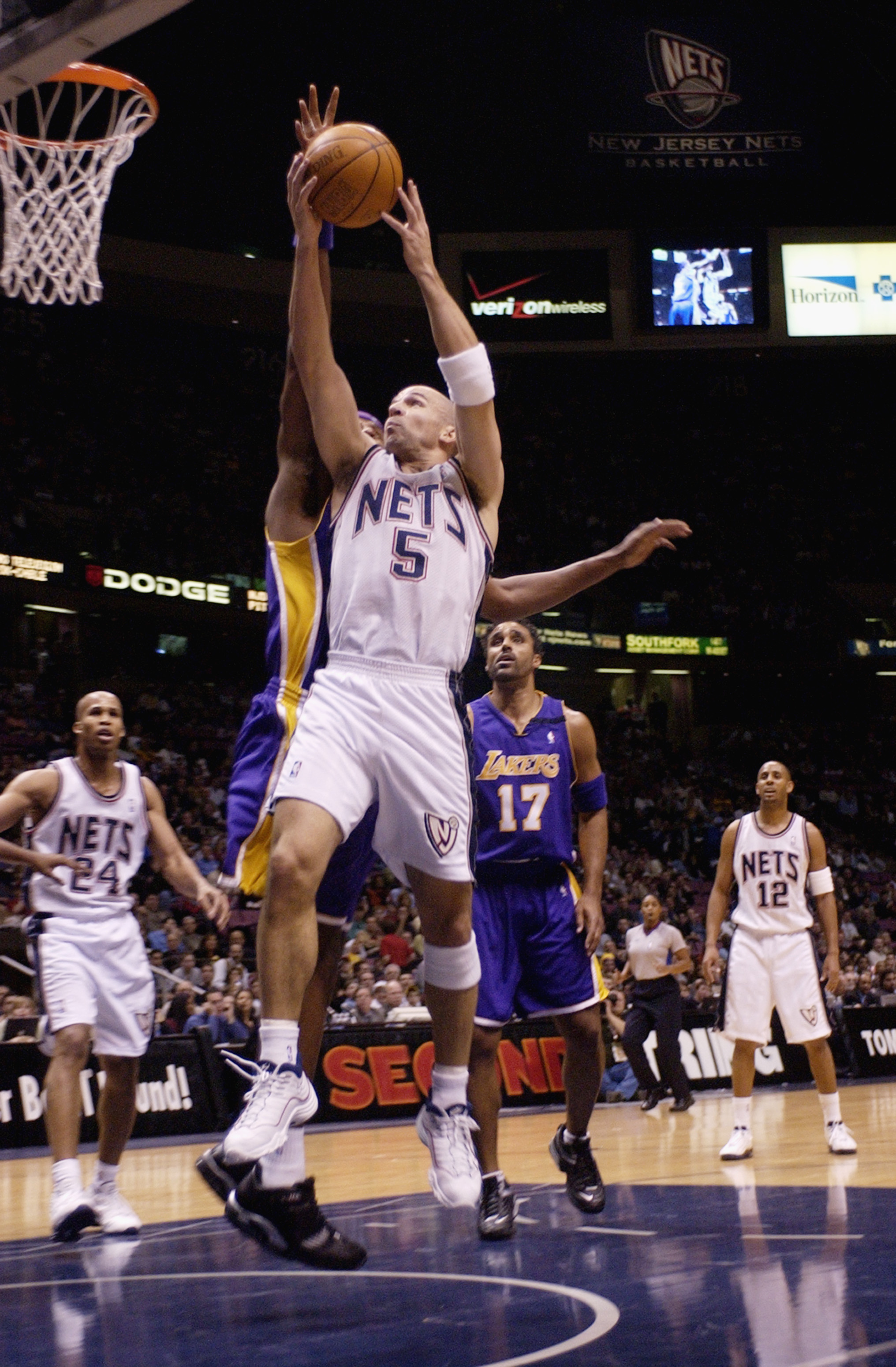 EAST RUTHERFORD, NJ - DECEMBER 19:  Jason Kidd #5 of the New Jersey Nets shoots a driving layup against the Los Angeles Lakers during the NBA game at Continental Airlines Arena on December 19, 2002 in East Rutherford, New Jersey.  The Nets won 98-71.  NOT