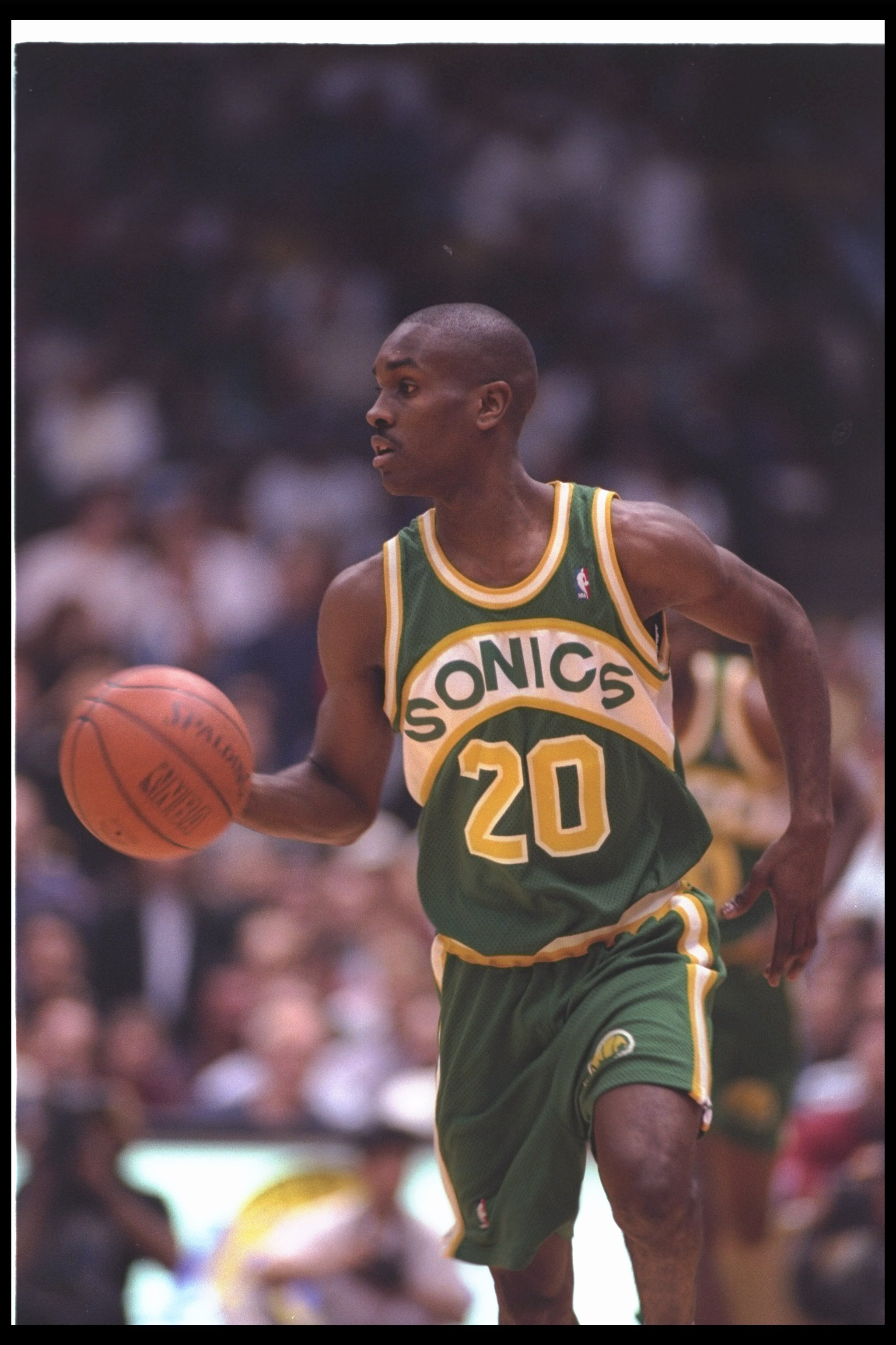 29 Dec 1993:  Guard Gary Payton of the Seattle SuperSonics moves the ball during a game against the Los Angeles Lakers at the Great Western Forum in Inglewood, California. Mandatory Credit: J. D. Cuban  /Allsport Mandatory Credit: J. D. Cuban  /Allsport