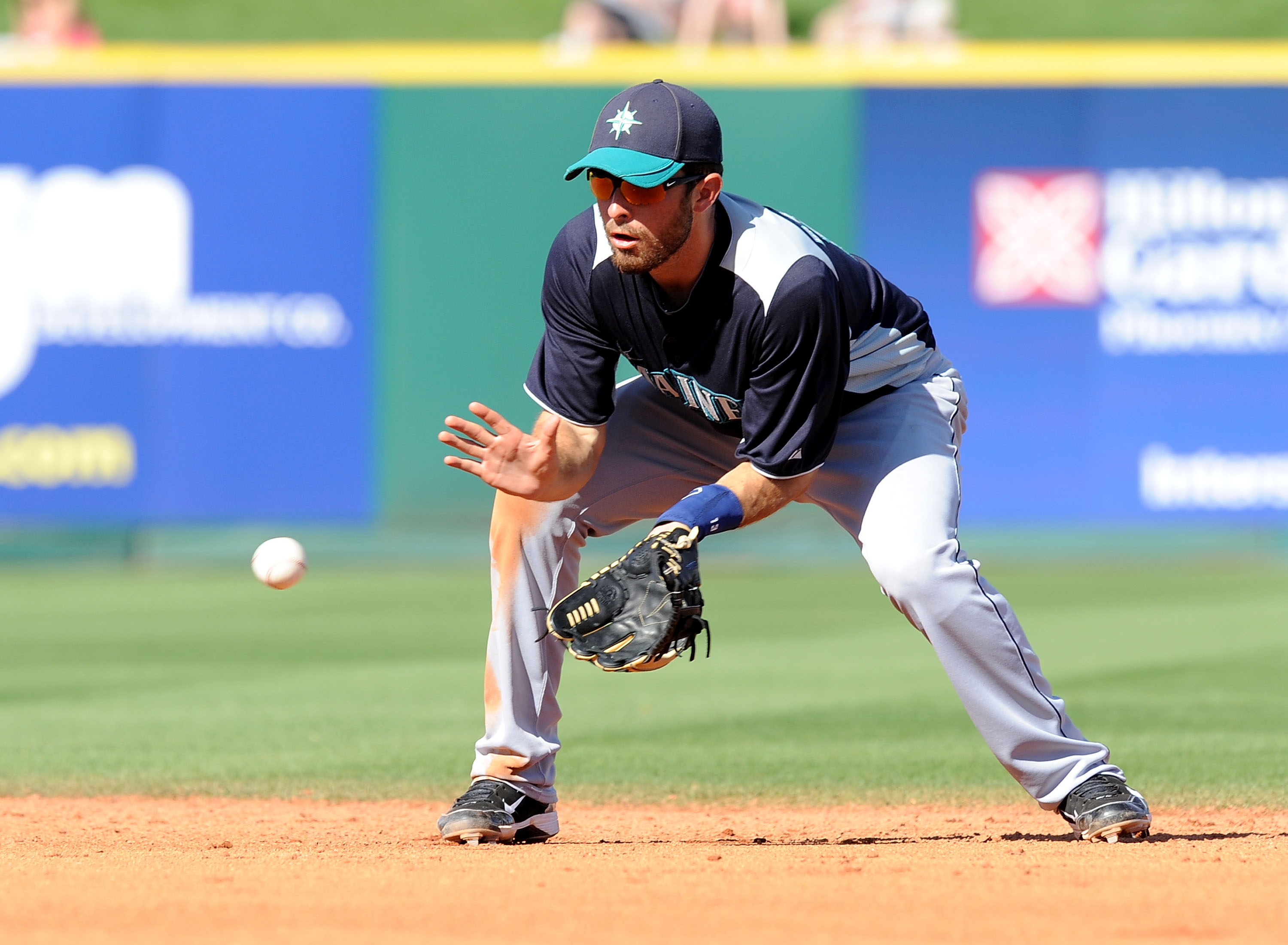 GOODYEAR, AZ - MARCH 11:  Dustin Ackley #13 of the Seattle Mariners fields a ground ball against the Cleveland Indians at Goodyear Ballpark on March 11, 2011 in Goodyear, Arizona.  (Photo by Norm Hall/Getty Images)