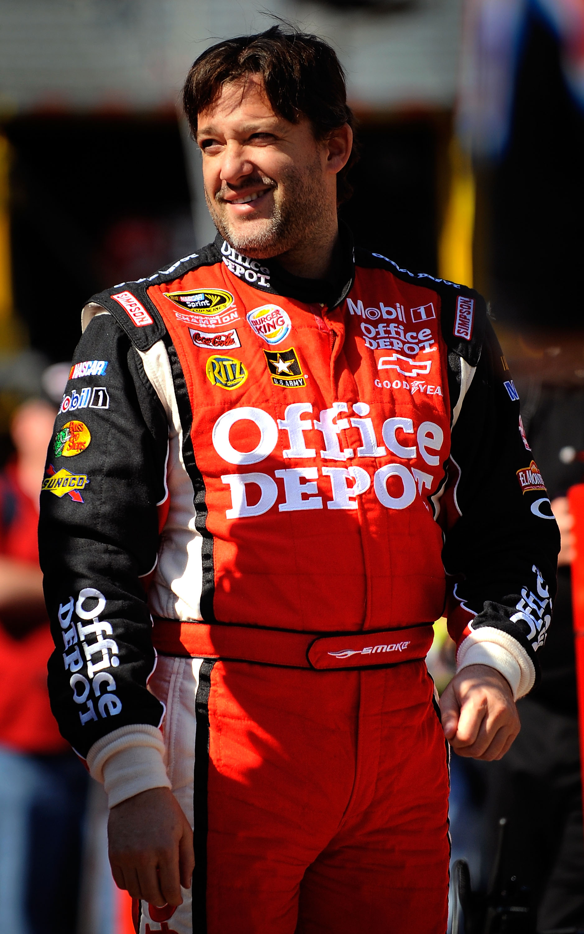 BRISTOL, TN - MARCH 19:  Tony Stewart, driver of the #14 Office Depot/Mobil 1 Chevrolet, walks in the garage area during practice for the NASCAR Sprint Cup Series Jeff Byrd 500 Presented By Food City at Bristol Motor Speedway on March 19, 2011 in Bristol,