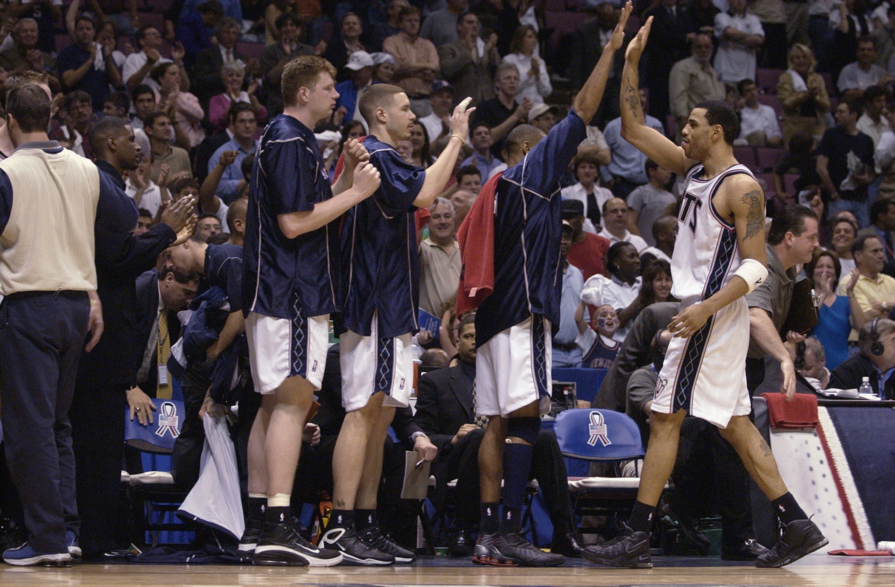 EAST RUTHERFORD, NJ - MAY 29:  Forward Kenyon Martin #6 of the New Jersey Nets returns to congratulations from his teammates on the bench in Game five of the Eastern Conference Finals against the Boston Celtics during the 2002 NBA Playoffs at Continental