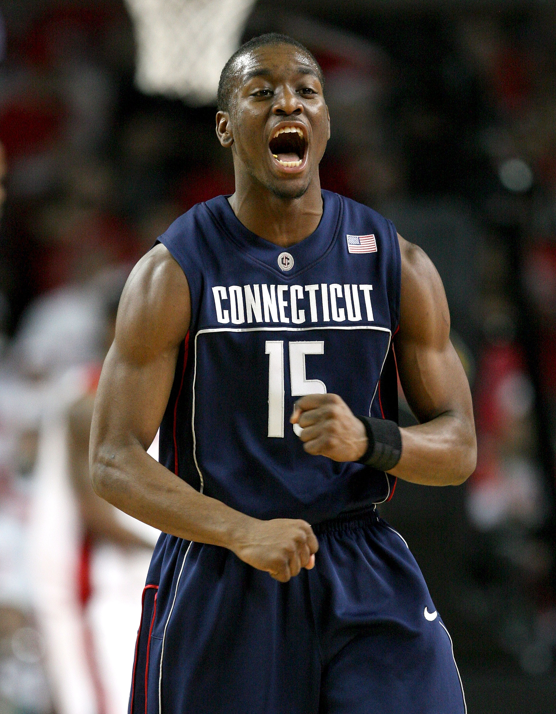 LOUISVILLE, KY - FEBRUARY 02:  Kemba Walker #15 of the Connecticut Huskies celebrates during the Big East Conference game against the Louisville Cardinals on February 2, 2009 at Freedom Hall in Louisville, Kentucky.  (Photo by Andy Lyons/Getty Images)