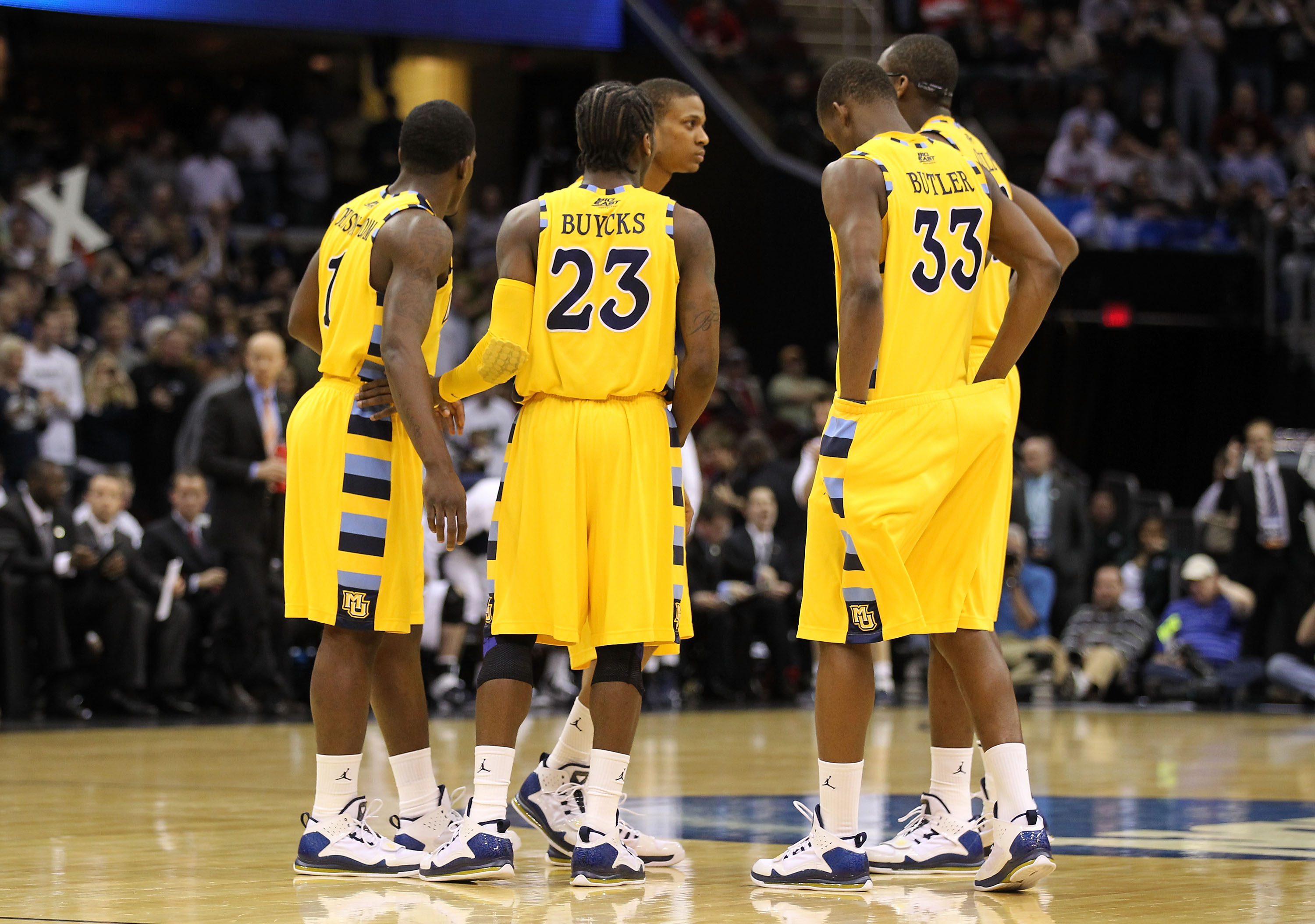CLEVELAND, OH - MARCH 18: Darius Johnson-Odom #1, Dwight Buycks #23 and Jimmy Butler #33 of the Marquette Golden Eagles huddle with teammates during the game against the Xavier Musketeers during the second round of the 2011 NCAA men's basketball tournamen