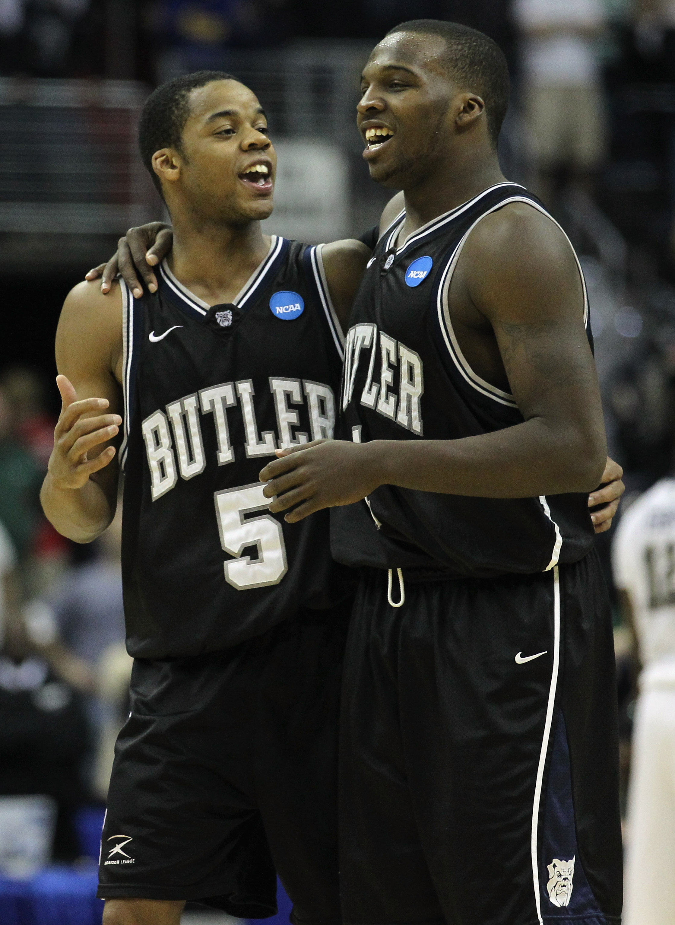 WASHINGTON - MARCH 19:  Ronald Nored #5 of Butler University celebrates with teammate Shelvin Mack #1 following their game against Pittsburgh in the third round of the 2011 NCAA men's basketball tournament at Verizon Center on March 19, 2011 in Washington