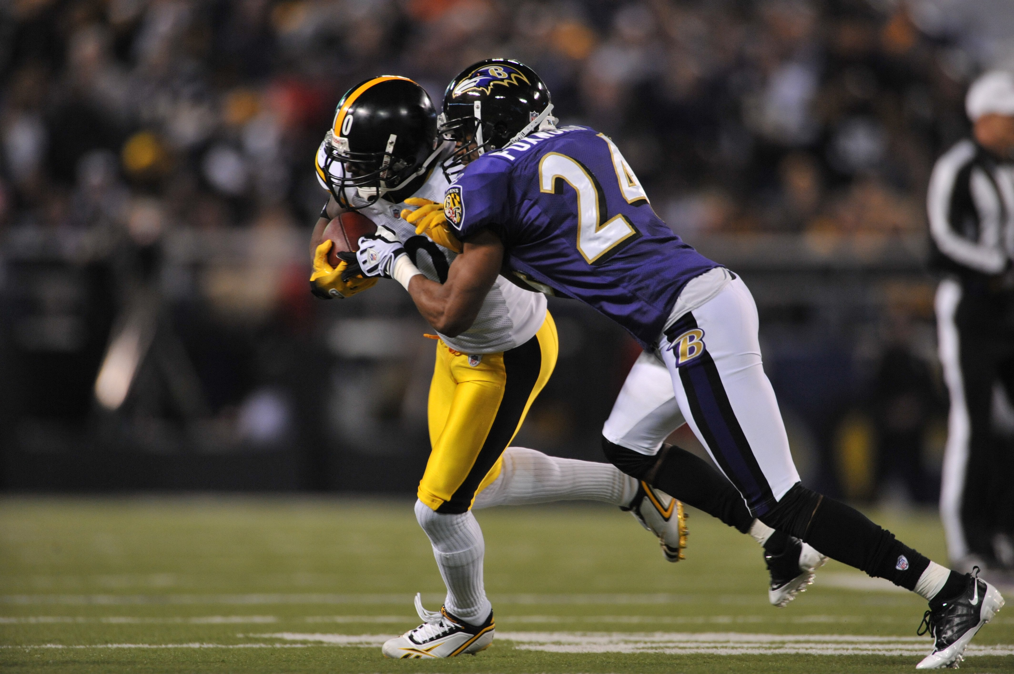 BALTIMORE - NOVEMBER 29:  Domonique Foxworth #24 of the Baltimore Ravens makes a tackle against the Pittsburgh Steelers at M&T Bank Stadium on November 29, 2009 in Baltimore, Maryland. The Ravens defeated the Steelers 20-17. (Photo by Larry French/Getty I