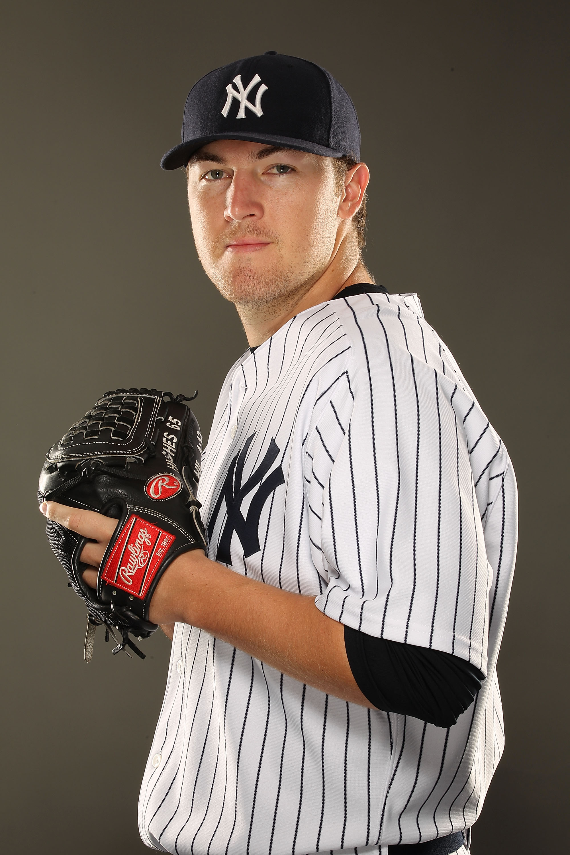 TAMPA, FL - FEBRUARY 23:  Phil Hughes #65 of the New York Yankees poses for a portrait on Photo Day at George M. Steinbrenner Field on February 23, 2011 in Tampa, Florida.  (Photo by Al Bello/Getty Images)
