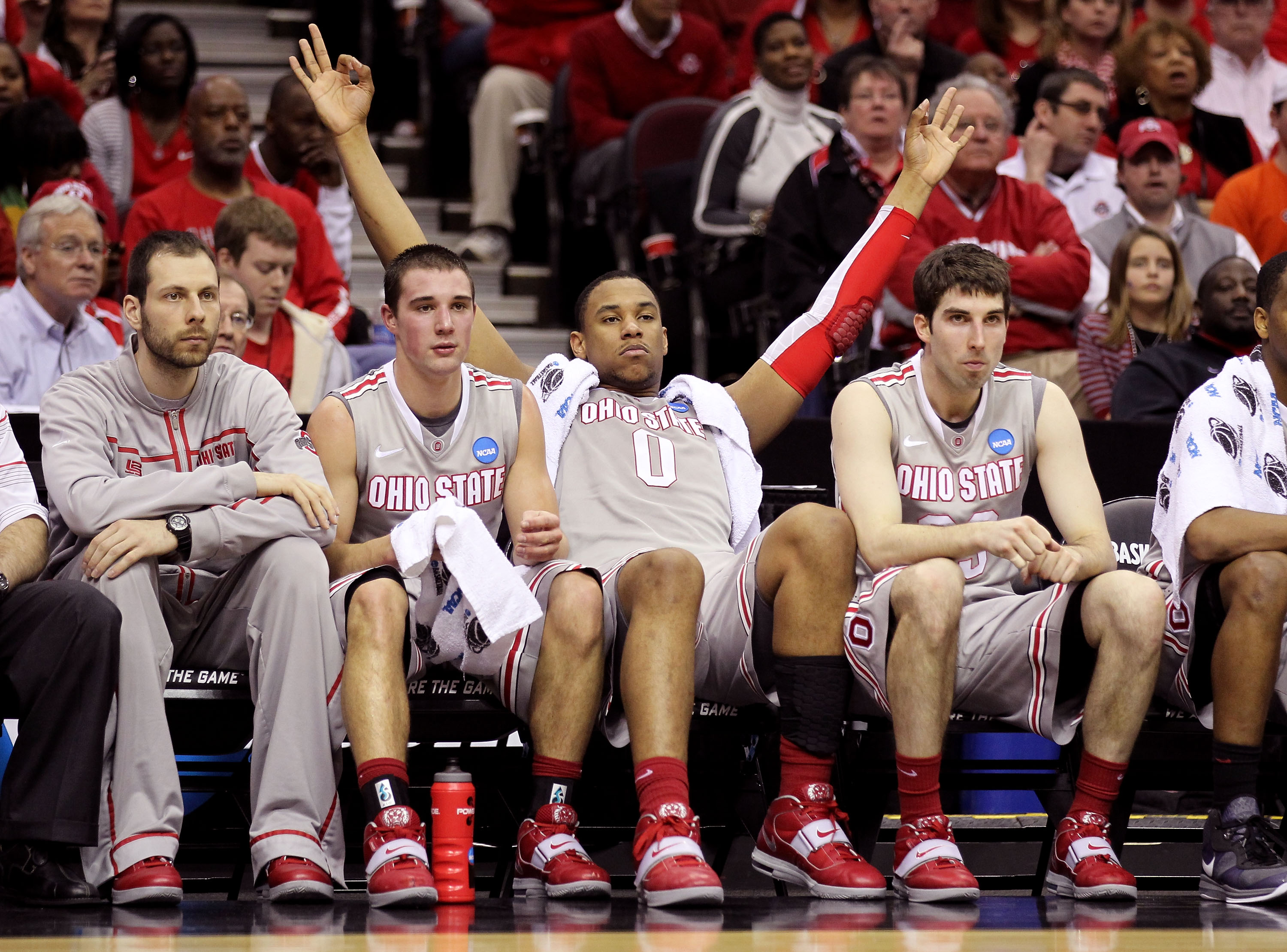 CLEVELAND, OH - MARCH 20: Aaron Craft #4, Jared Sullinger #0 and Jon Diebler #33 of the Ohio State Buckeyes look on from the bench late in the second half against the George Mason Patriots during the third of the 2011 NCAA men's basketball tournament at Q