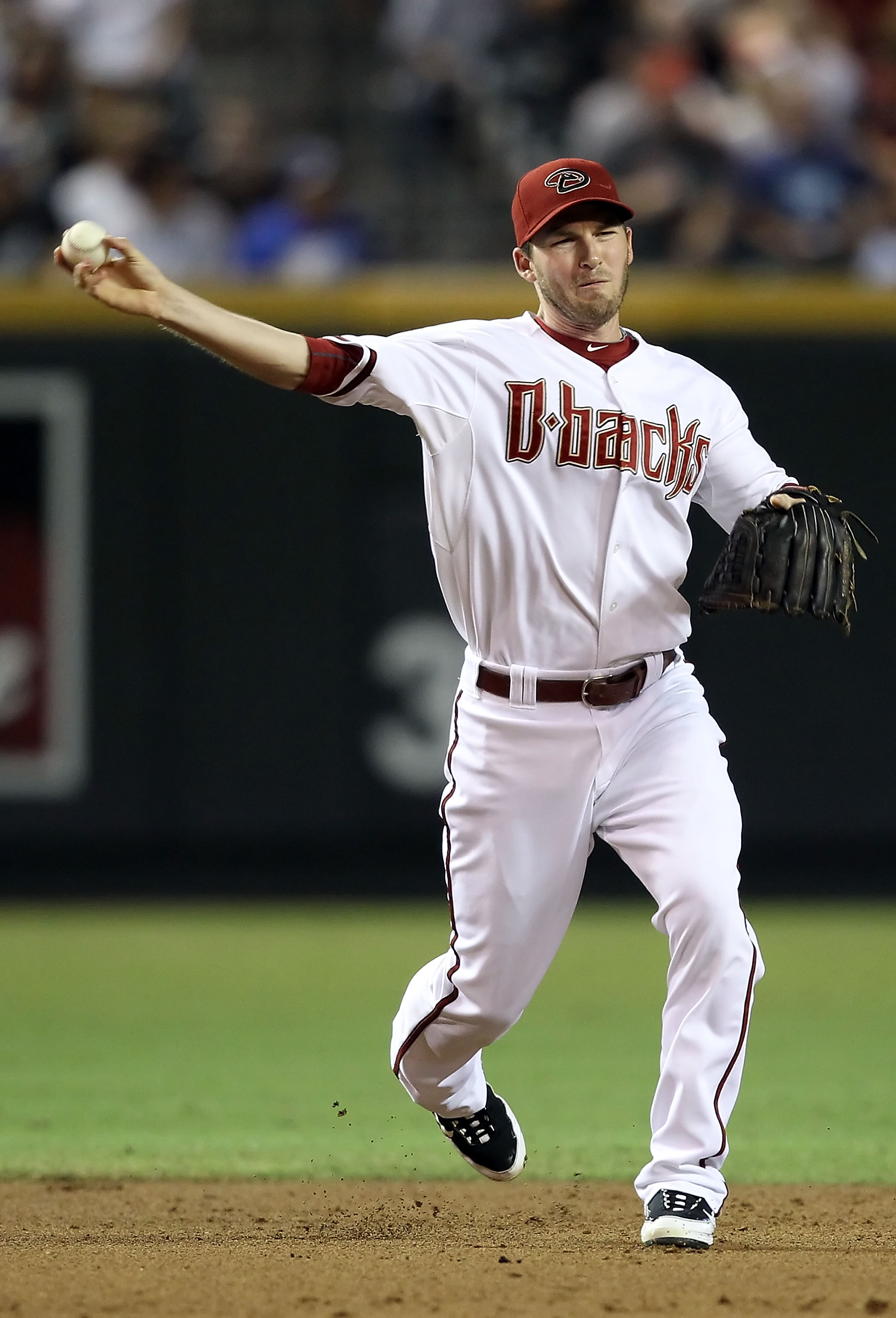 PHOENIX - SEPTEMBER 24:  Infielder Stephen Drew #6 of the Arizona Diamondbacks fields a ground ball out during the Major League Baseball game against the Los Angeles Dodgers at Chase Field on September 24, 2010 in Phoenix, Arizona.  (Photo by Christian Pe