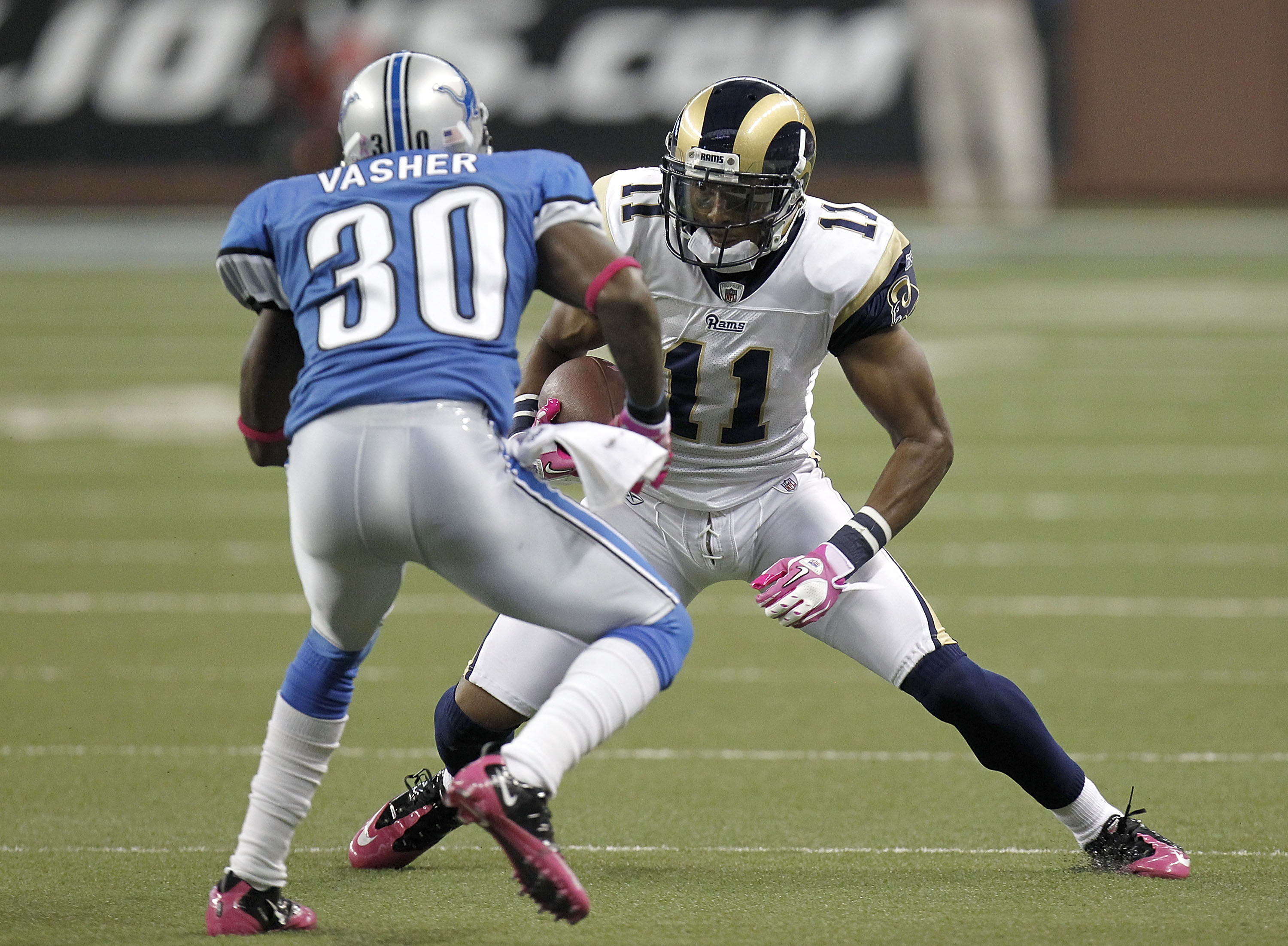 DETROIT - OCTOBER 10: Brandon Gibson #11 of the St. Louis Rams tries to get around the tackle of Nathan Vasher #30 of the Detroit Lions on October 10, 2010 at Ford Field in Detroit, Michigan.  (Photo by Gregory Shamus/Getty Images)
