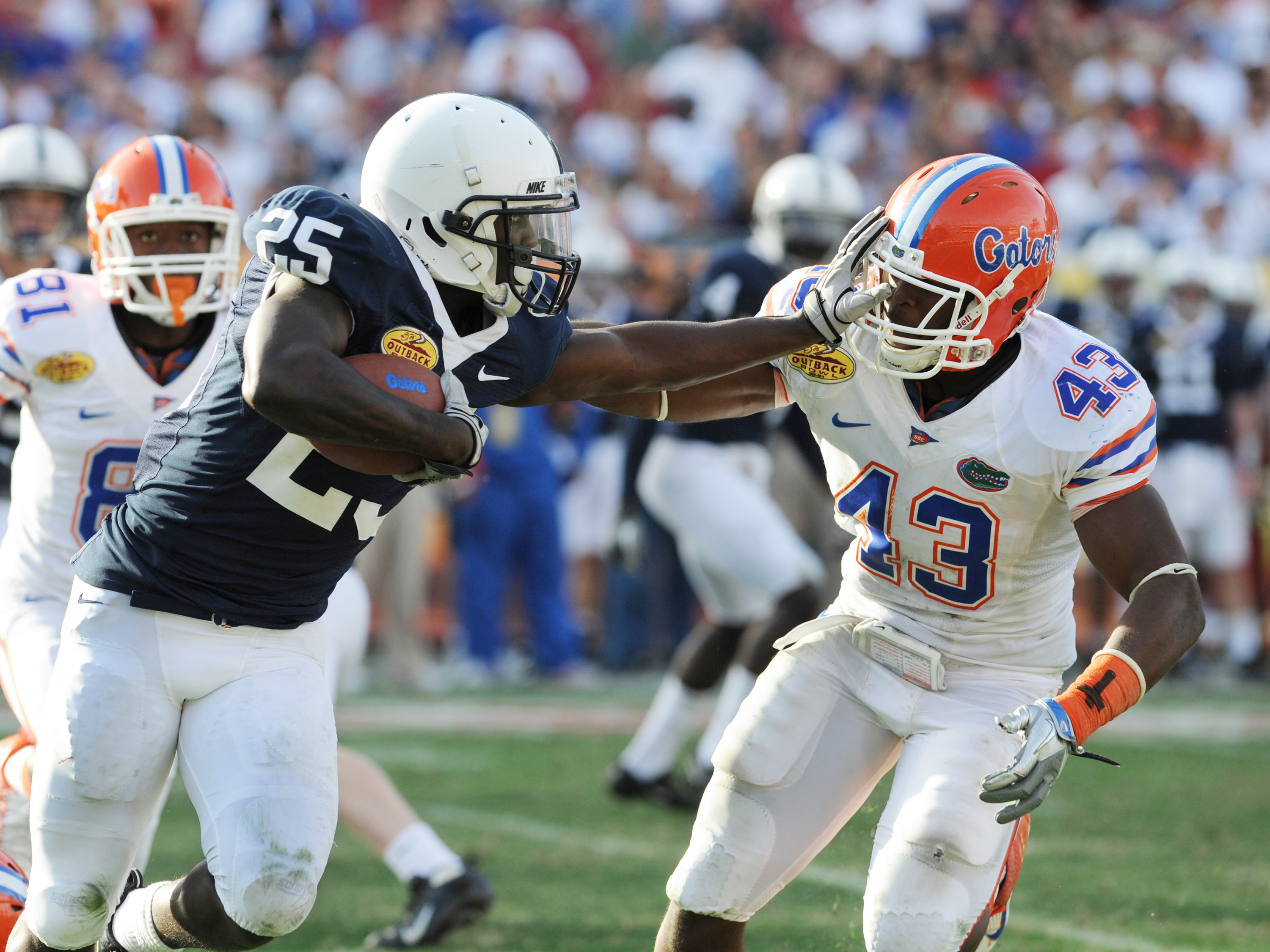 TAMPA, FL - JANUARY 1:  Running back Evan Royster #22 of the Penn State Nittany Lions pushed off linebacker Jelani Jenkins #43 of  the Florida Gators January 1, 2010 in the 25th Outback Bowl at Raymond James Stadium in Tampa, Florida.  (Photo by Al Messer