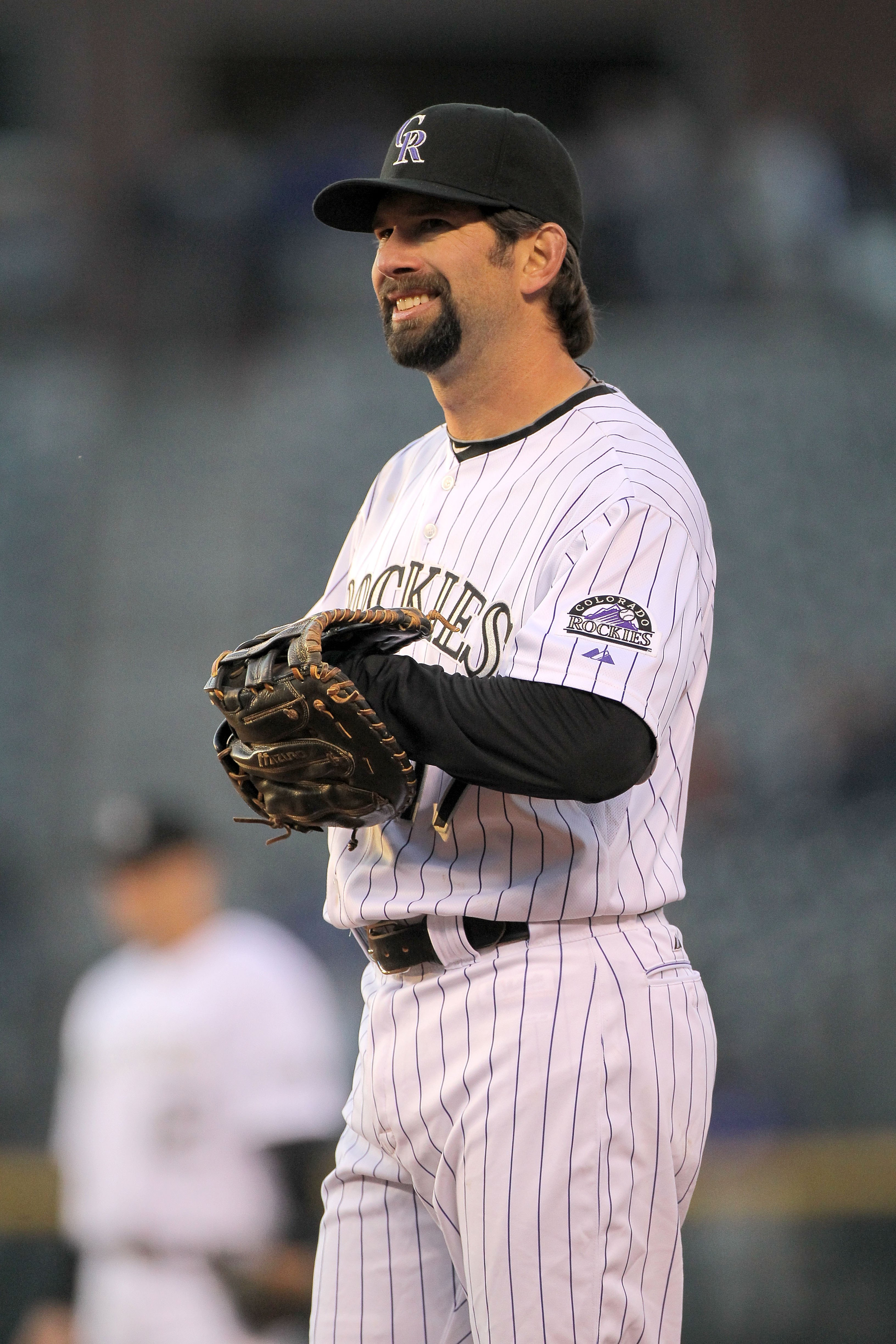 DENVER - APRIL 13:  Todd Helton #17 of the Colorado Rockies looks on as he defends against the New York Mets during Major League Baseball action at Coors Field on April 13, 2010 in Denver, Colorado.  (Photo by Doug Pensinger/Getty Images)