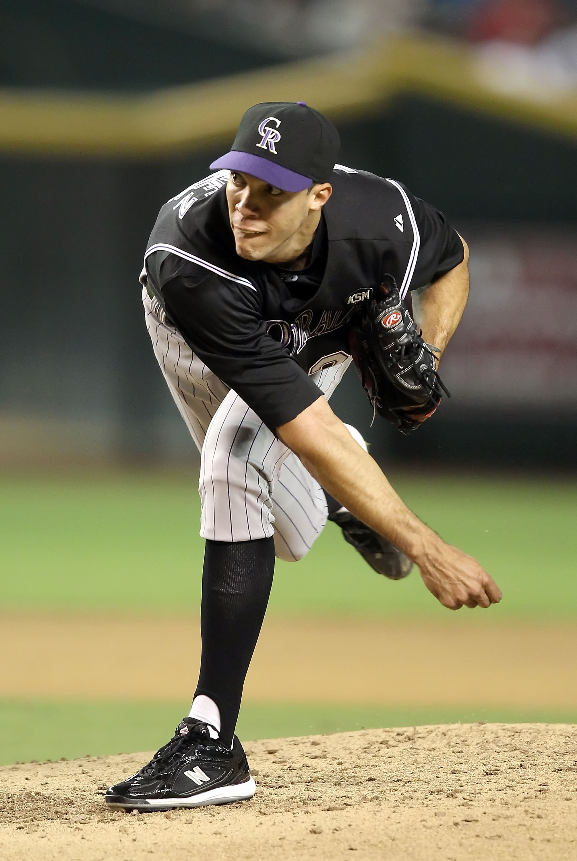 PHOENIX - SEPTEMBER 22:  Starting pitcher Ubaldo Jimenez #38 of the Colorado Rockies pitches against the Arizona Diamondbacks during the Major League Baseball game at Chase Field on September 22, 2010 in Phoenix, Arizona.  (Photo by Christian Petersen/Get
