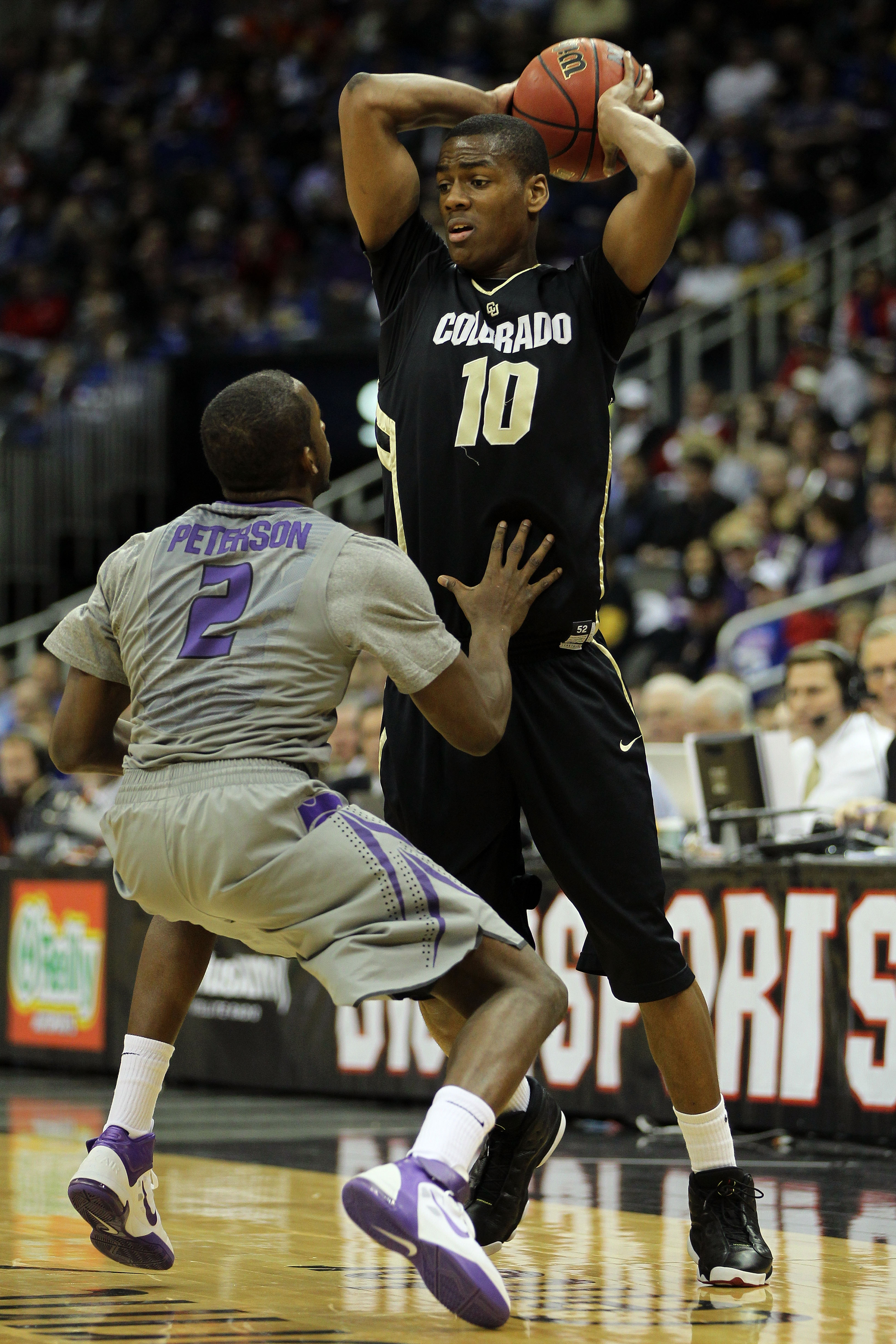 KANSAS CITY, MO - MARCH 10:  Alec Burks #10 of the Colorado Buffaloes looks to move the ball as Devon Peterson #2 of the Kansas State Wildcats defends during their quarterfinal game in the 2011 Phillips 66 Big 12 Men's Basketball Tournament at Sprint Cent