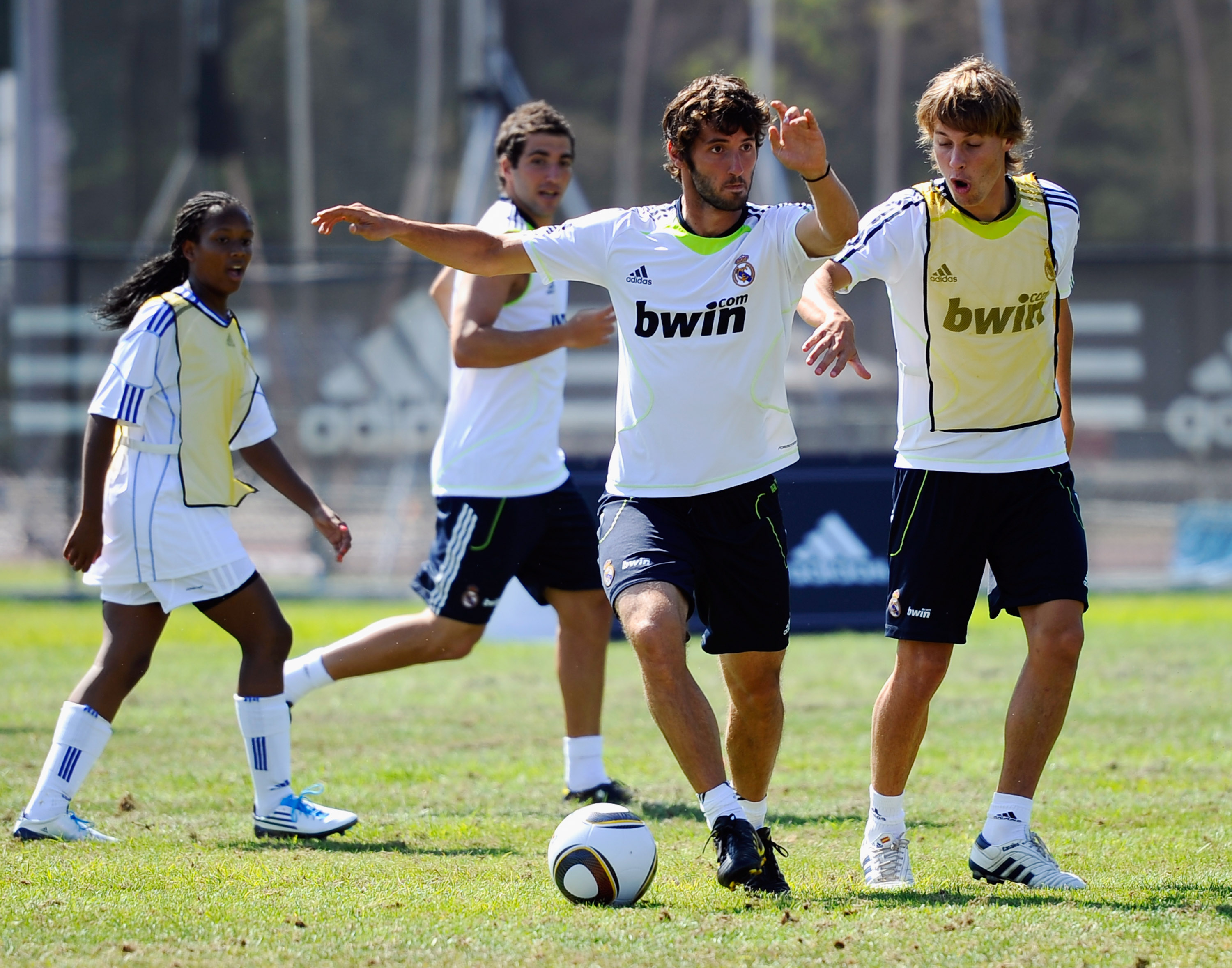 LOS ANGELES, CA - AUGUST 05:  Esteban Granero #24 (C) and Sergio Canales #27 of Real Madrid and  local youth soccer players participate in the Adidas training on August 5, 2010 in Westwood section of Los Angeles, California.  (Photo by Kevork Djansezian/G