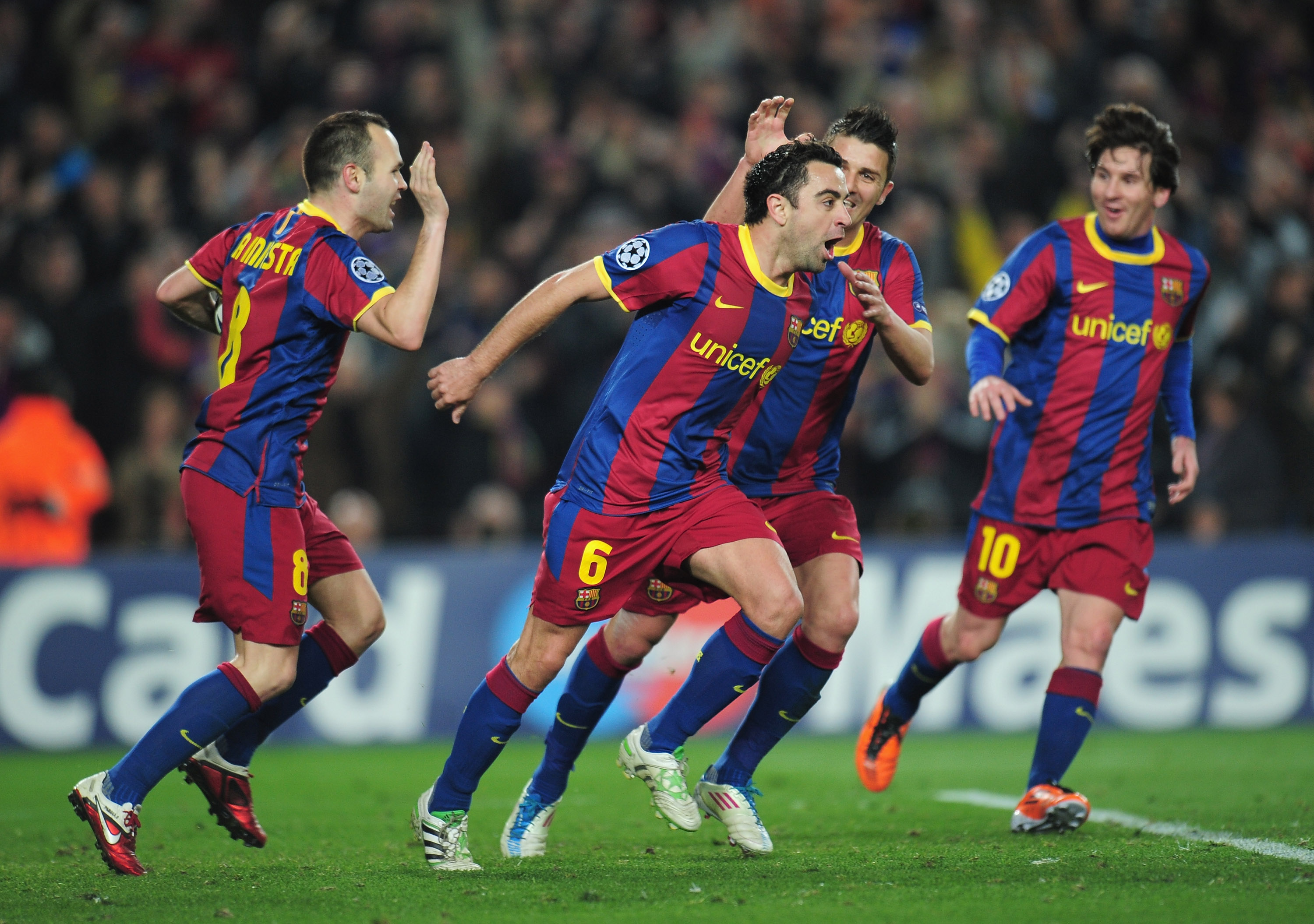 BARCELONA, SPAIN - MARCH 08:  Xavi Hernandez of Barcelona celebrates with team-mates David Villa and Andres Iniesta during the UEFA Champions League round of 16 second leg match between Barcelona and Arsenal at the Nou Camp Stadium on March 8, 2011 in Bar