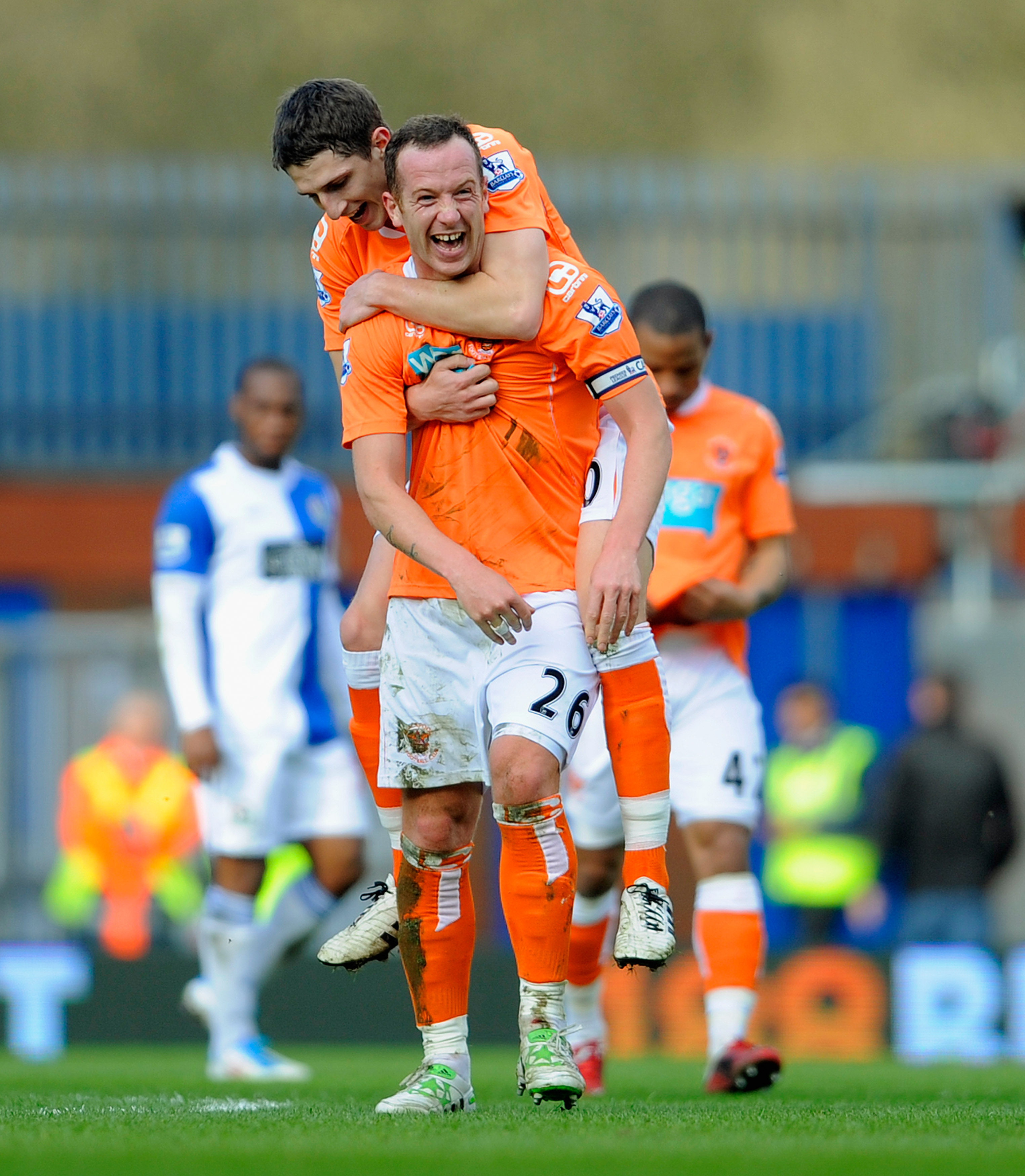 BLACKBURN, ENGLAND - MARCH 19: Charlie Adam of Blackpool celebrates with Craig Cathcart after scoring to make it 2-0 during the Barclays Premier League match between Blackburn Rovers and Blackpool at Ewood Park on March 19, 2011 in Blackburn, England.  (P