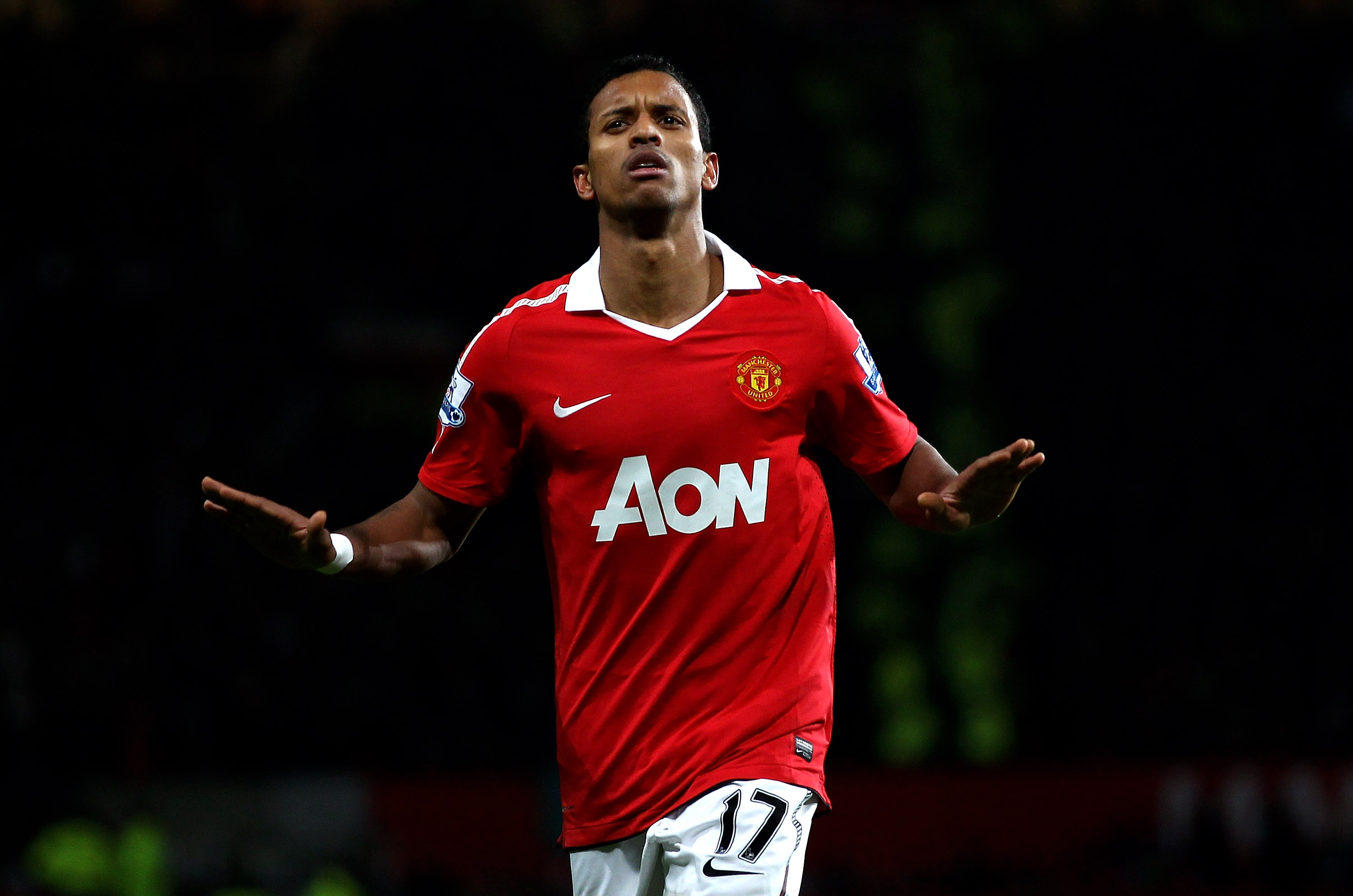 MANCHESTER, ENGLAND - JANUARY 04:   Nani of Manchester United celebrates scoring his team's second goal during the Barclays Premier League match between Manchester United and Stoke City at Old Trafford on January 4, 2011 in Manchester, England. (Photo by