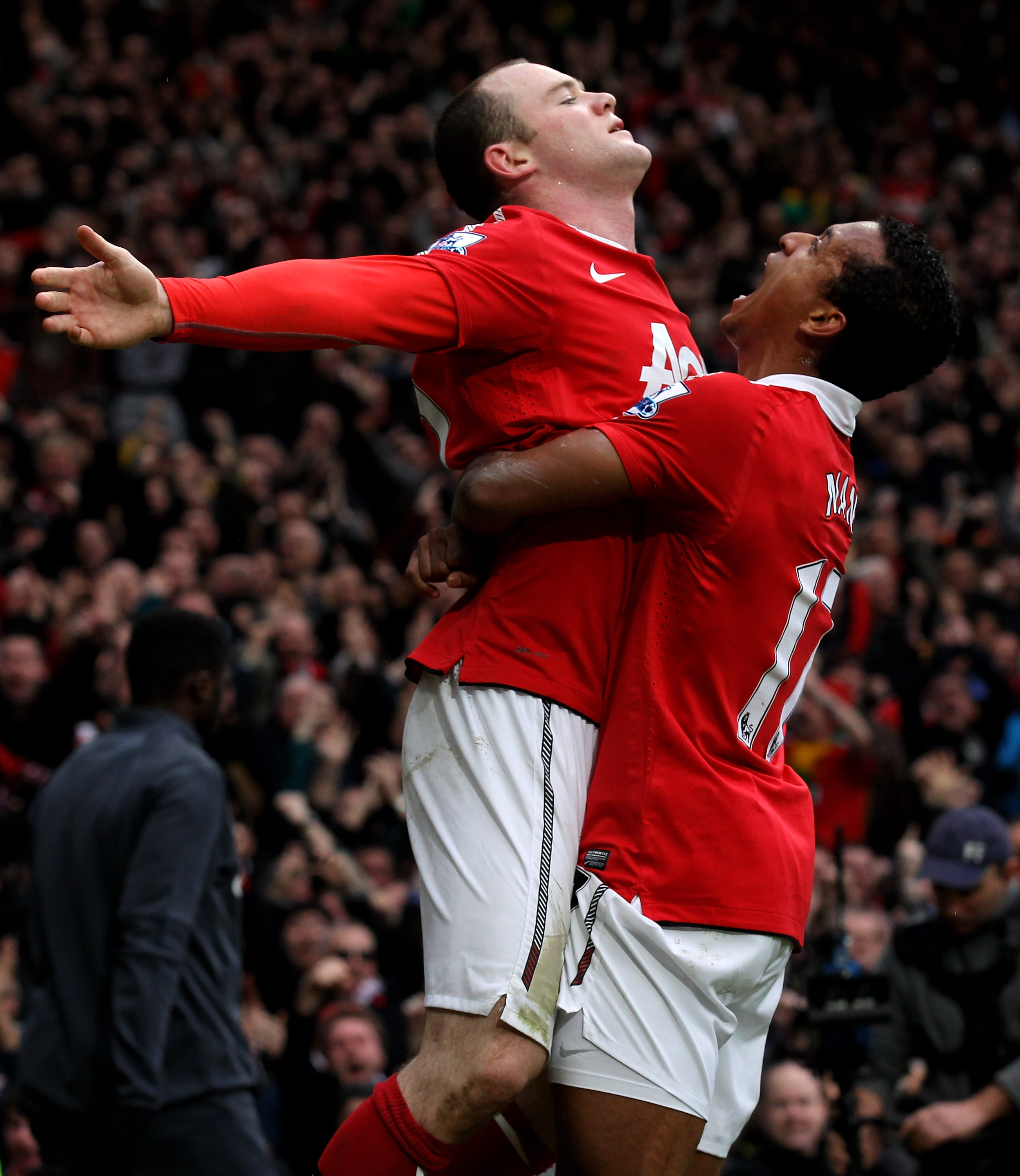 MANCHESTER, ENGLAND - FEBRUARY 12:  Wayne Rooney of Manchester United celebrates with teammate Nani (R) after he scores a goal from an overhead kick during the Barclays Premier League match between Manchester United and Manchester City at Old Trafford on