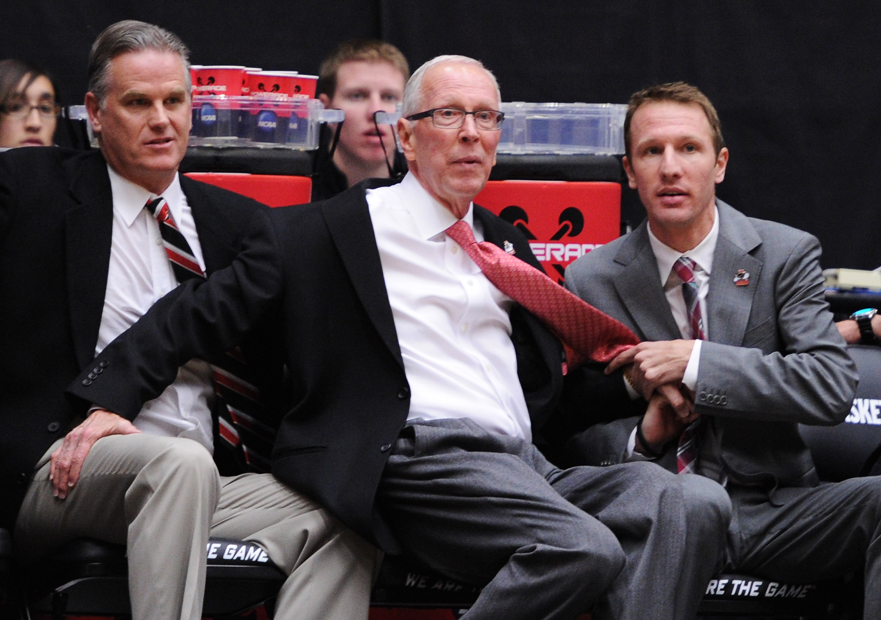 TUCSON, AZ - MARCH 19:  Head coach Steve Fisher (C) of the San Diego State Aztecs stumbles during their game against the Temple Owls during the third round of the 2011 NCAA men's basketball tournament at McKale Center on March 19, 2011 in Tucson, Arizona.