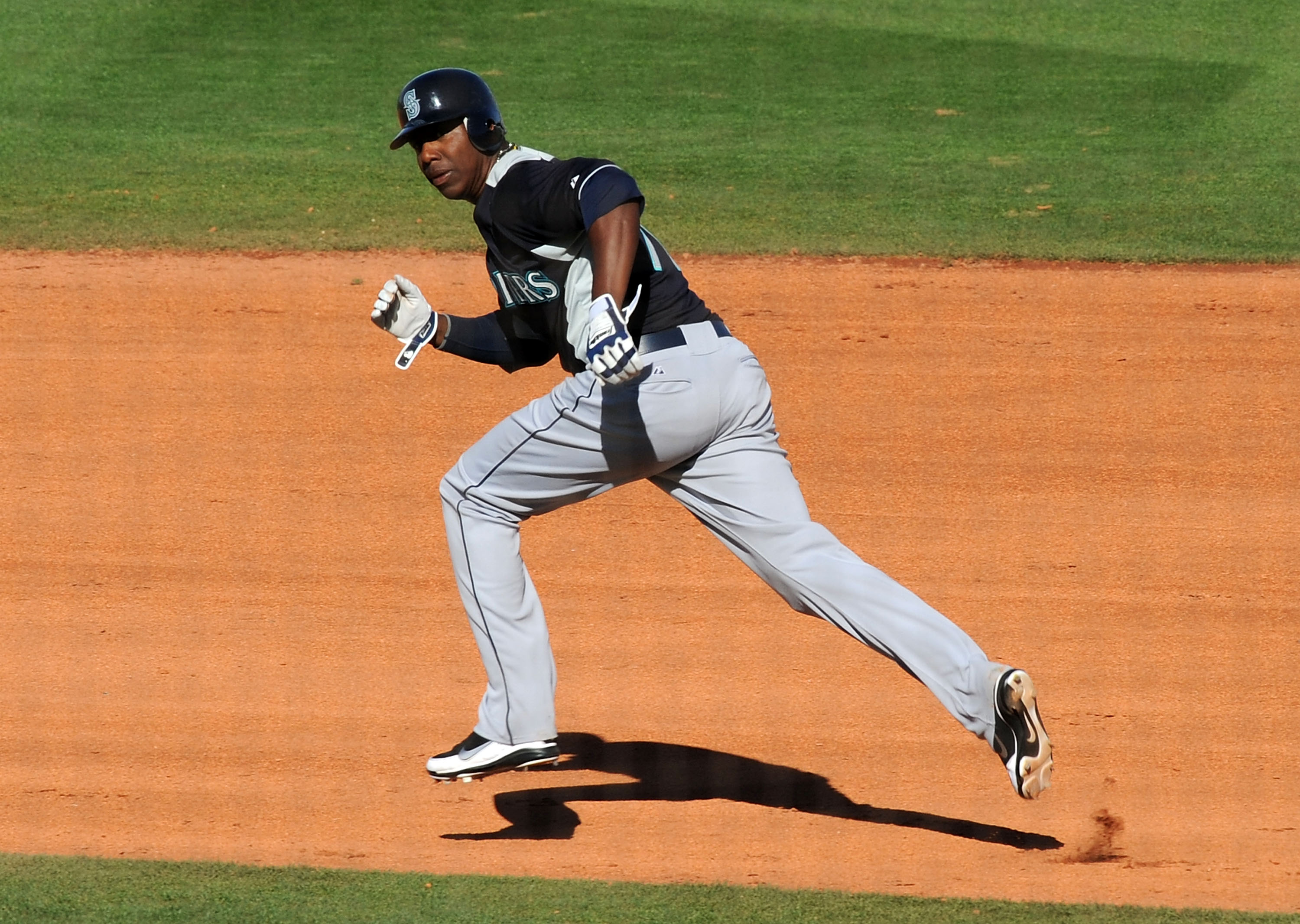 GOODYEAR, AZ - MARCH 11:  Johermyn Chavez #70 of the Seattle Mariners runs to second base while watching for the ball against the Cleveland Indians at Goodyear Ballpark on March 11, 2011 in Goodyear, Arizona.  (Photo by Norm Hall/Getty Images)