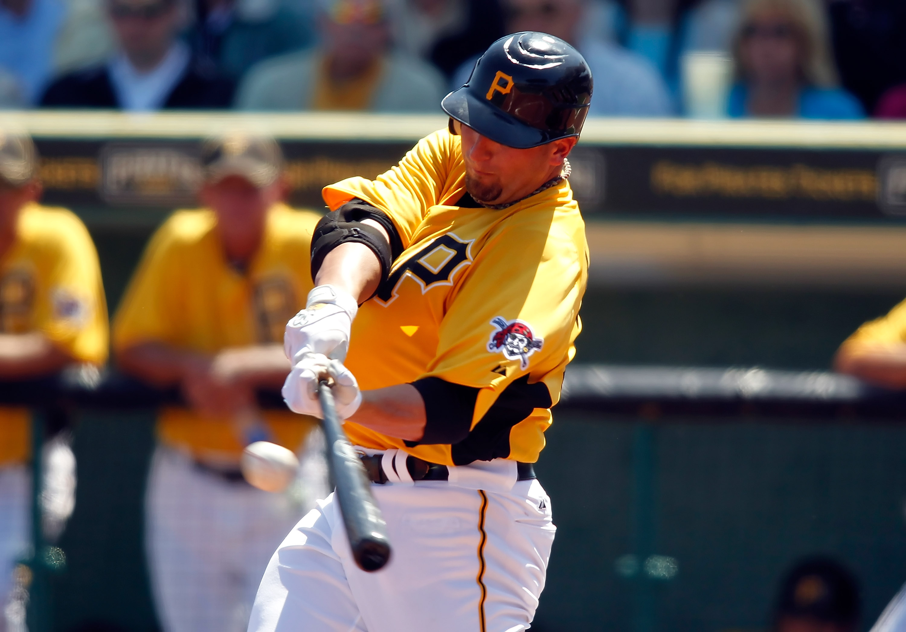 BRADENTON, FL - MARCH 13:  Pitcher Brad Lincoln #32 of the Pittsburgh Pirates gets a base hit against the Boston Red Sox during a Grapefruit League Spring Training Game at McKechnie Field on March 13, 2011 in Bradenton, Florida.  (Photo by J. Meric/Getty