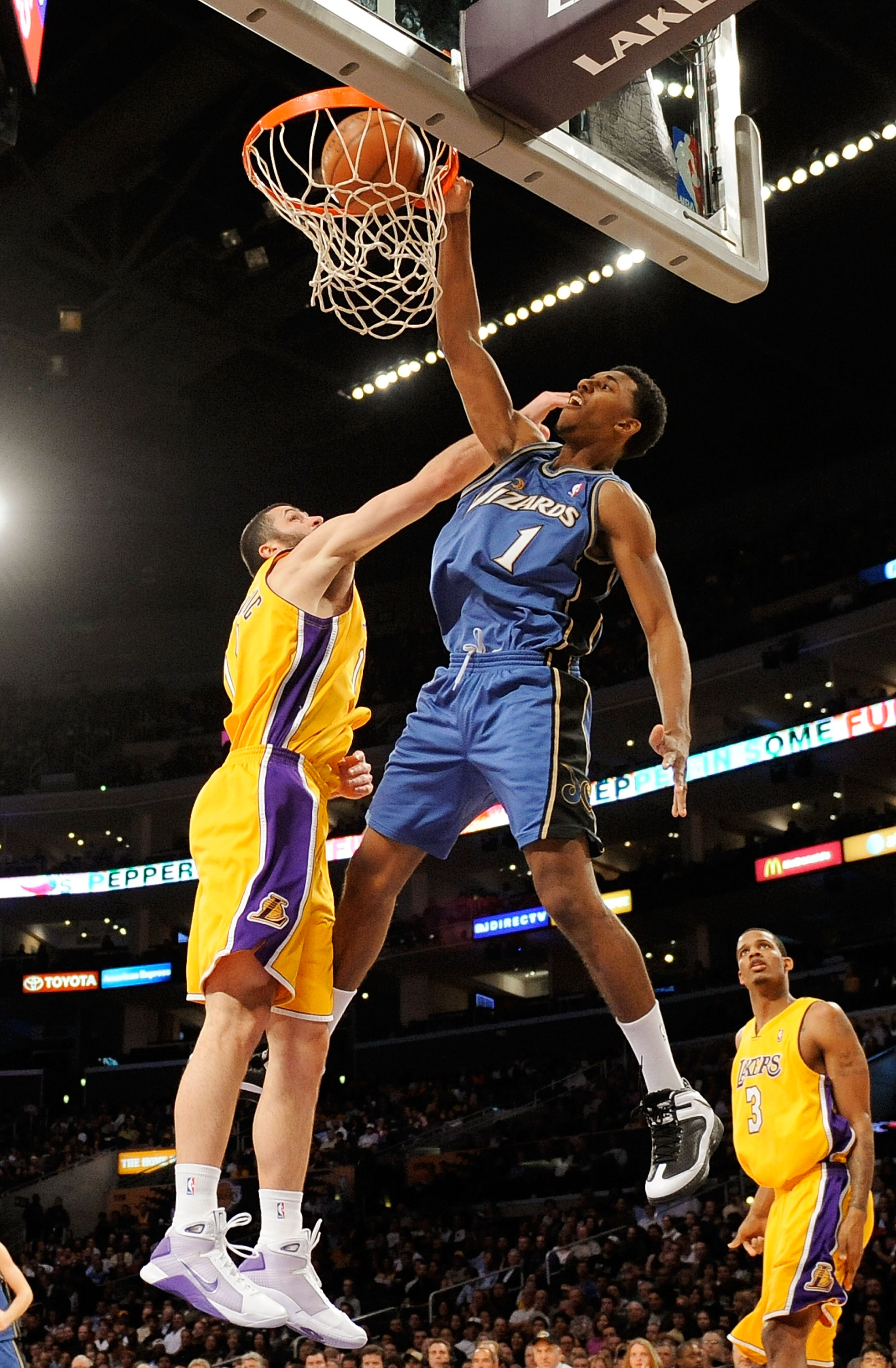 LOS ANGELES, CA - JANUARY 22:  Nick Young #1 of the Washington Wizards dunks against Vladimir Radmanovic #10 of the Los Angeles Lakers during the fourth quarter at the Staples Center January 22, 2009 in Los Angeles, California. NOTE TO USER: User expressl