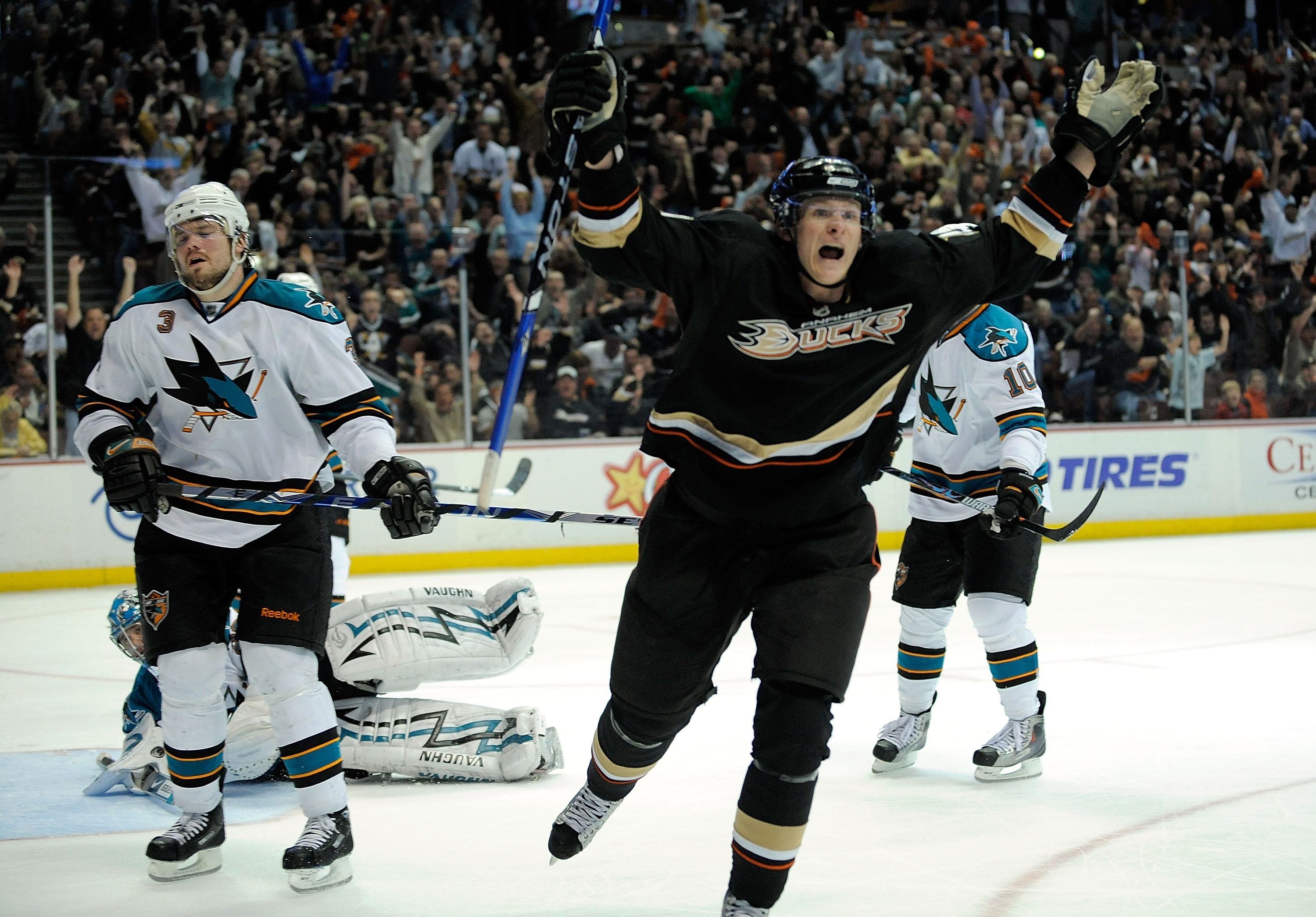 ANAHEIM, CA - APRIL 23:   Douglas Murray #3 of the San Jose Sharks reacts with closed eyes as Corey Perry #10 of the Anaheim Ducks celebrates his third period goal during Game Four of the Western Conference Quarterfinal Round of the 2009 Stanley Cup Playo