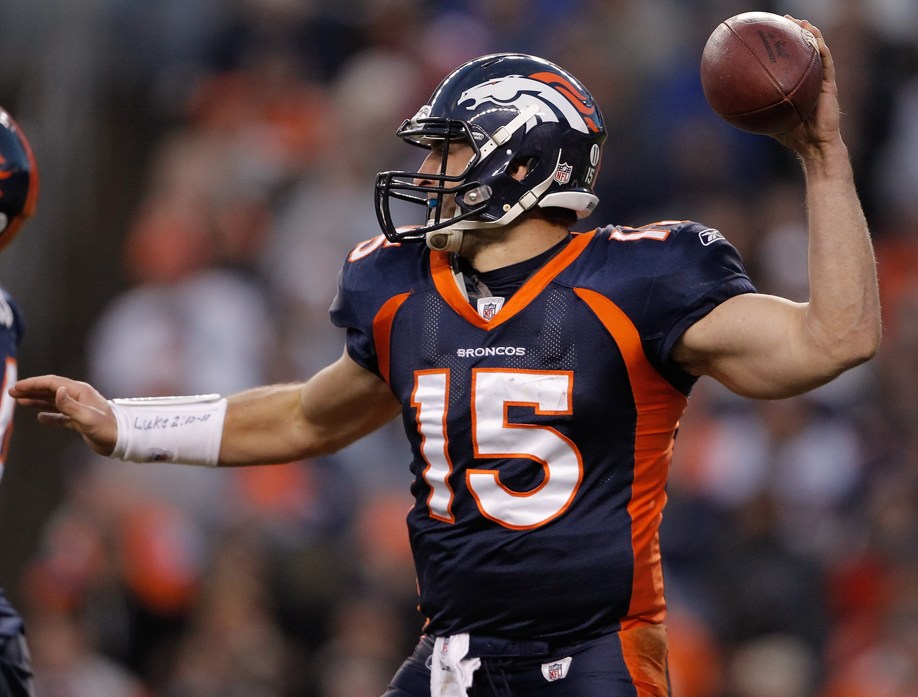 DENVER - DECEMBER 26:  Quarterback Tim Tebow #15 of the Denver Broncos throws a pass against the Houston Texans at INVESCO Field at Mile High on December 26, 2010 in Denver, Colorado.  The Denver Broncos defeated the Houston Texans 24-23. (Photo by Justin
