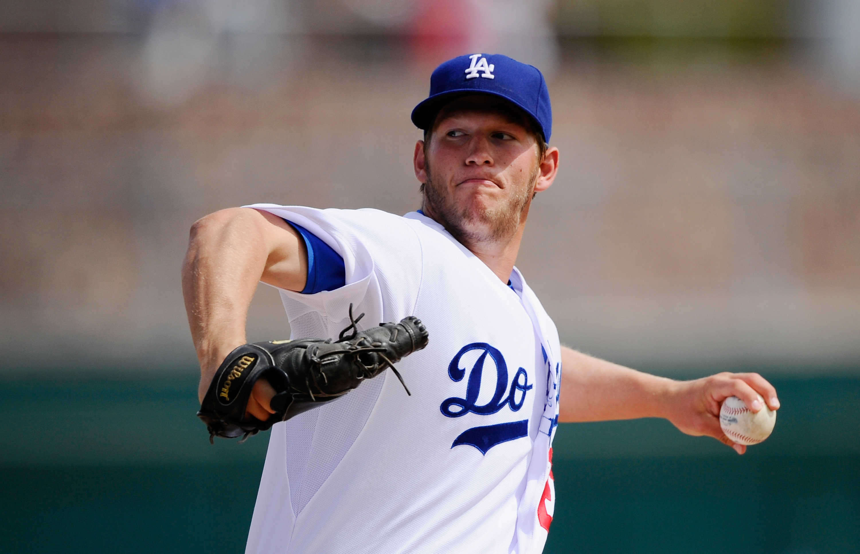 GLENDALE, AZ - MARCH 15:  Pitcher Clayton Kershaw #22 of the Los Angeles Dodgers throws a pitch against Texas Rangers during the spring training baseball game at Camelback Ranch on March 15, 2011 in Glendale, Arizona.  (Photo by Kevork Djansezian/Getty Im