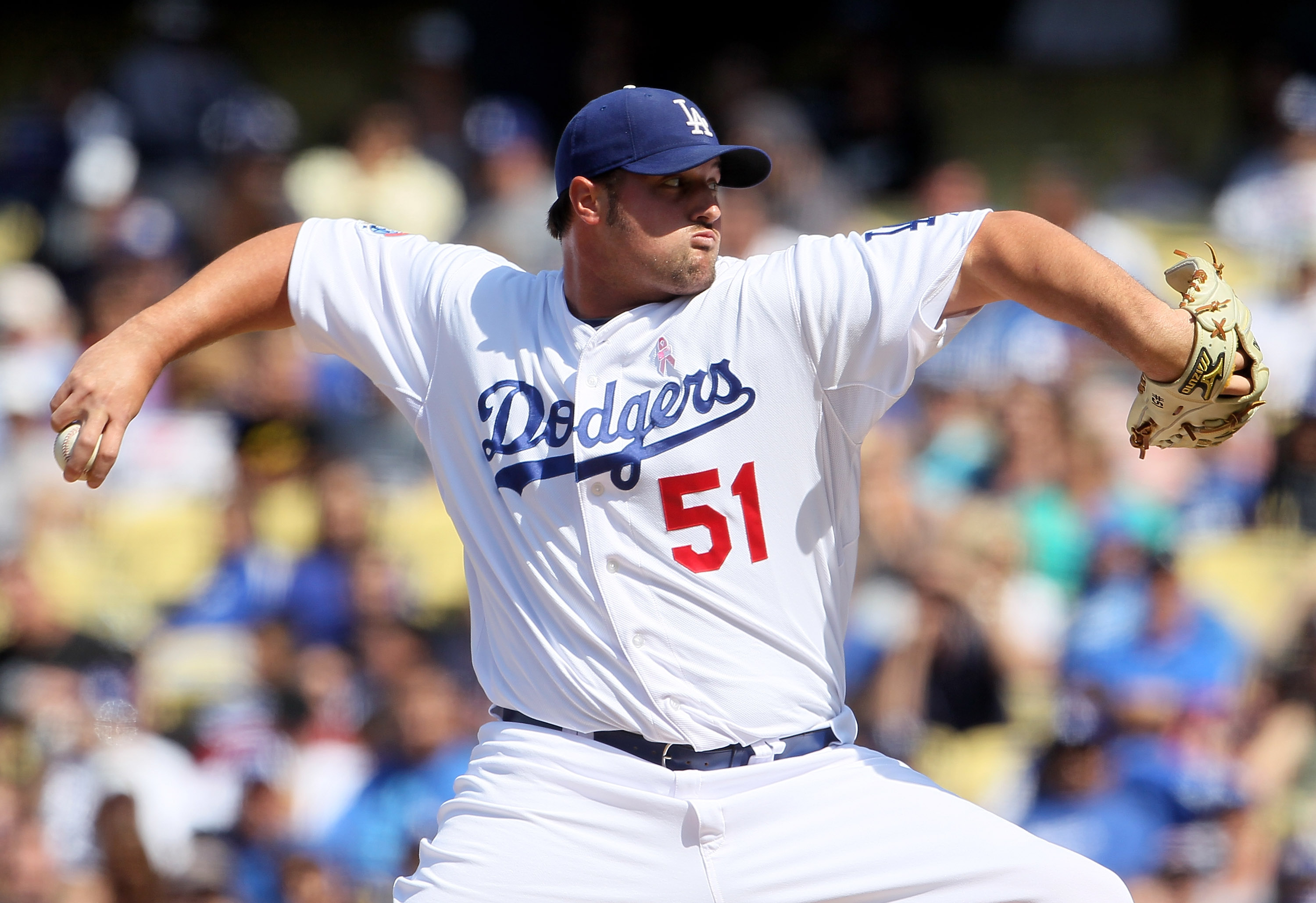 LOS ANGELES, CA - MAY 09:  Jonathan Broxton #51 of the Los Angeles Dodgers pitches against the Colorado Rockies in the ninth inning at Dodger Stadium on May 9, 2010 in Los Angeles, California. The Dodgers defeated the Rockies 2-0.  (Photo by Jeff Gross/Ge