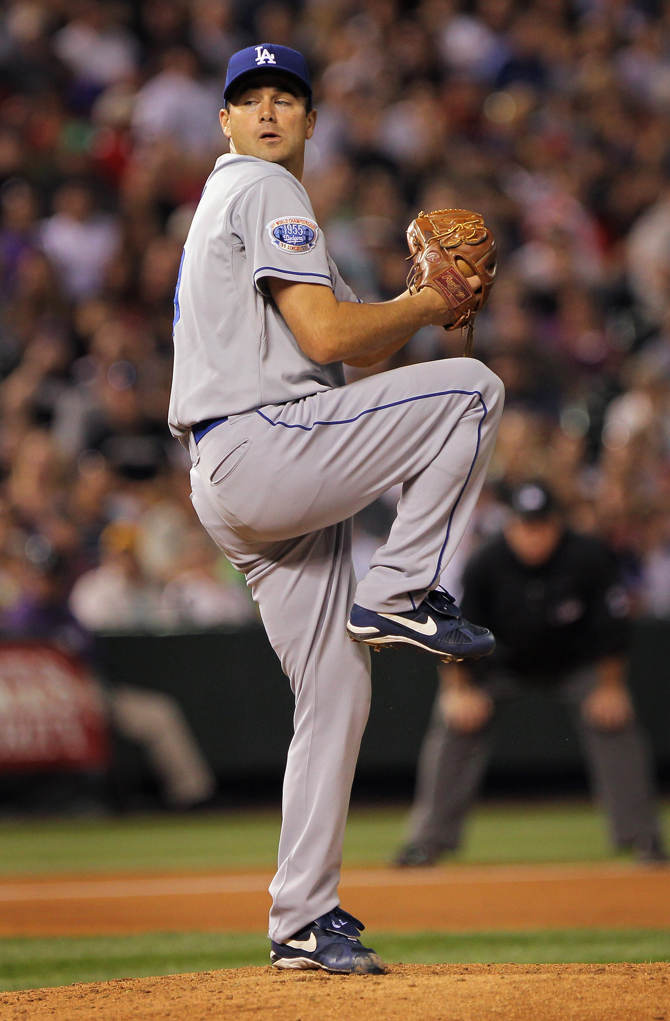 DENVER - SEPTEMBER 27:  Starting pitcher Ted Lilly #29 of the Los Angeles Dodgers delivers against the Colorado Rockies at Coors Field on September 25, 2010 in Denver, Colorado. Lilly earned the win as the Dodgers defeated the Rockies 3-1.  (Photo by Doug