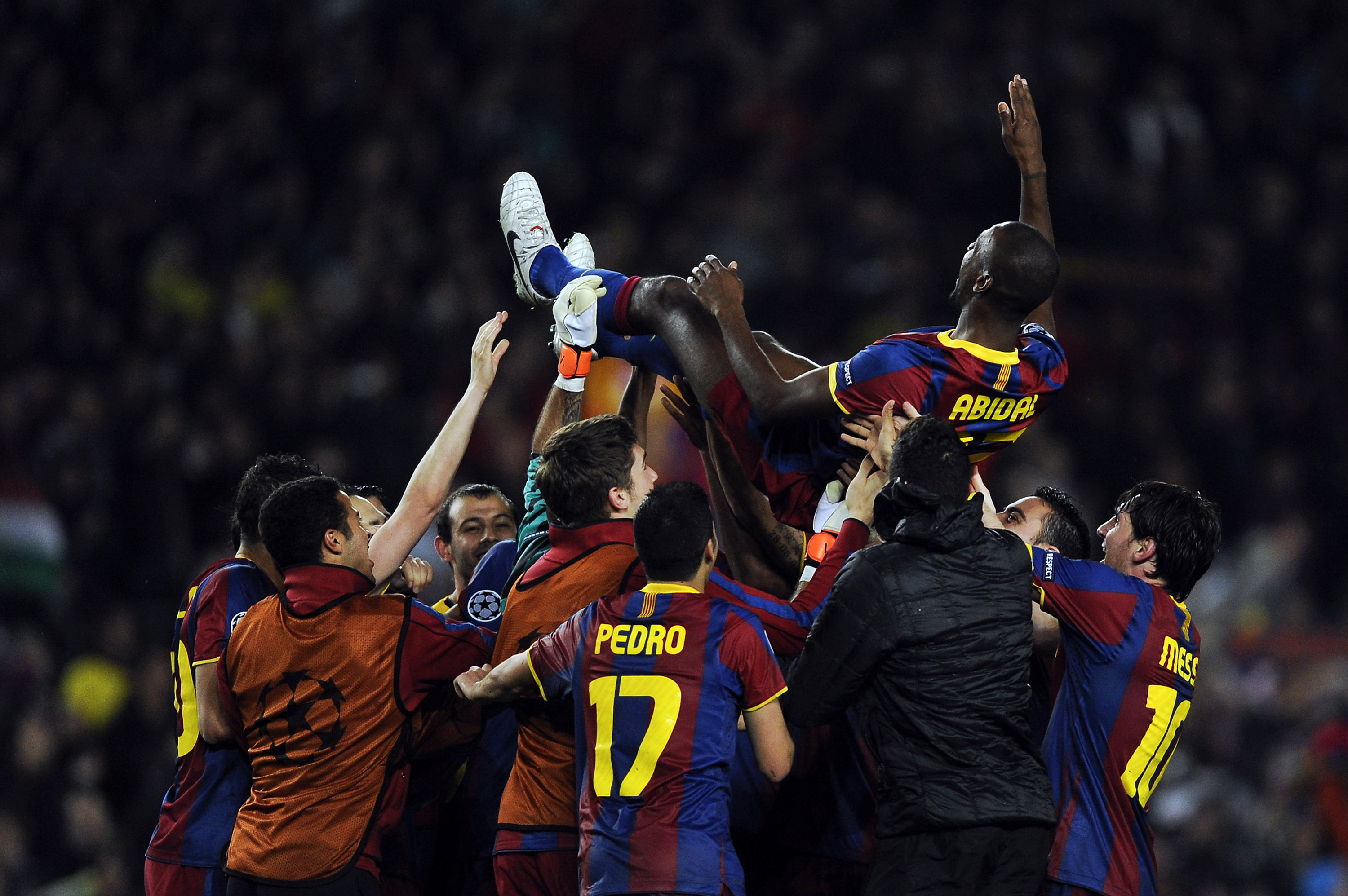 BARCELONA, SPAIN - MAY 03:  FC Barcelona players toss teammate Eric Abidal up in the air after defeating Real Madrid in the UEFA Champions League Semi Final second leg match between Barcelona and Real Madrid, at the Camp Nou on May 3, 2011 in Barcelona, S